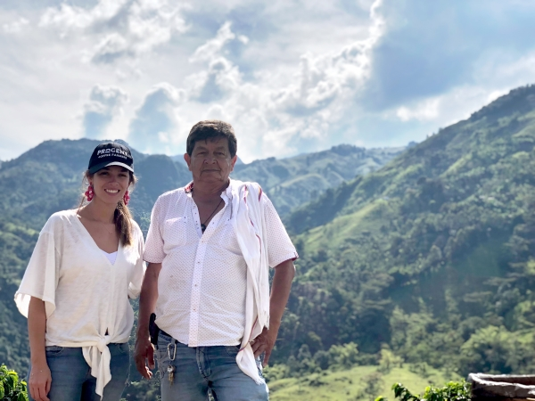 Maria Palacio, CEO of Progeny Coffee with a coffee farmer in Colombia.
