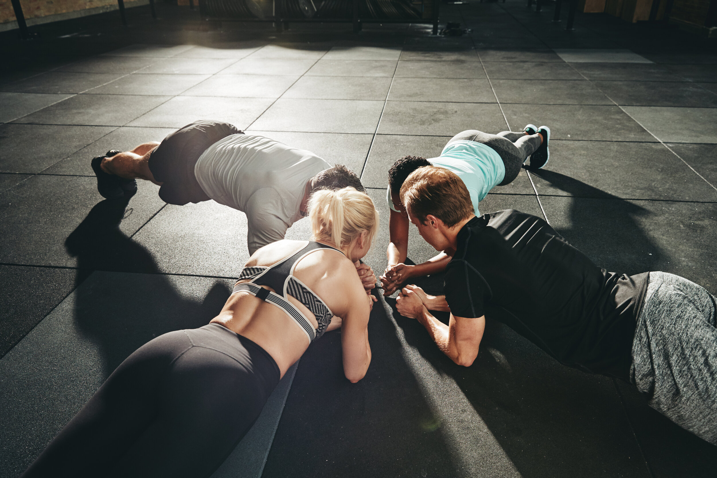 group-of-people-planking-together-on-a-gym-floor-THRN62F.jpg