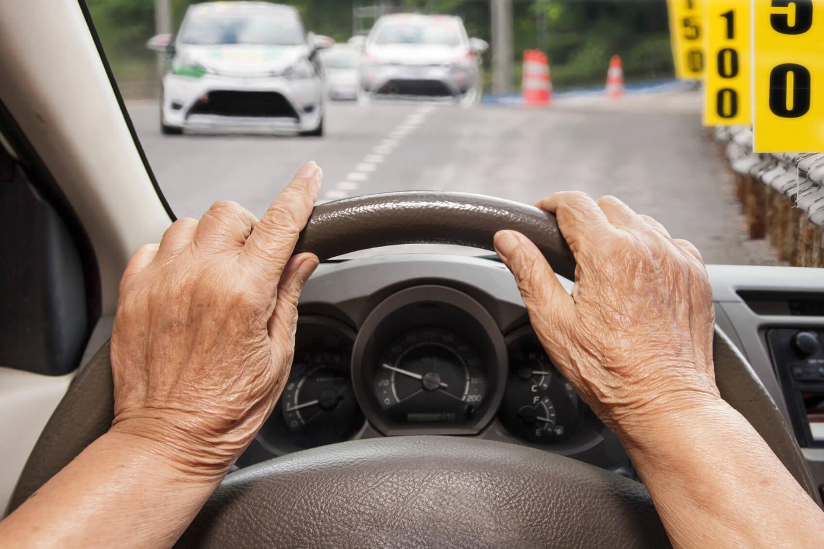 senior-hands-driving