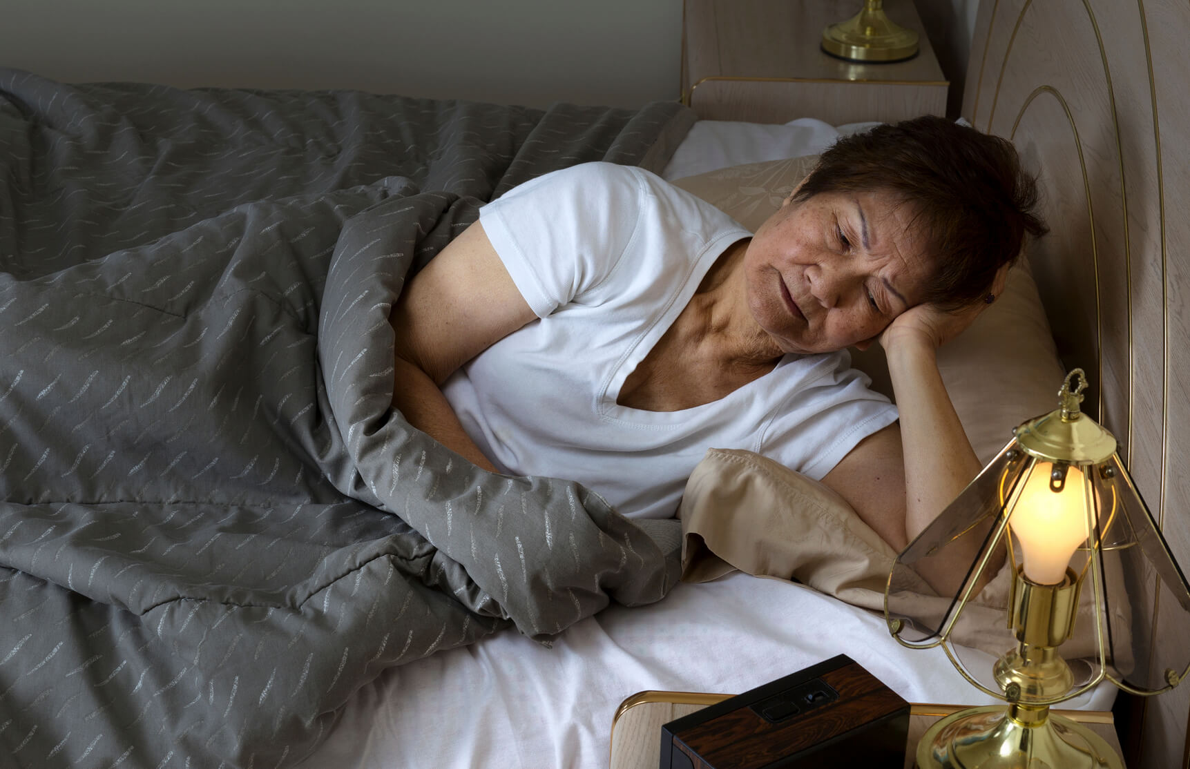 mature-woman-lying-in-bed