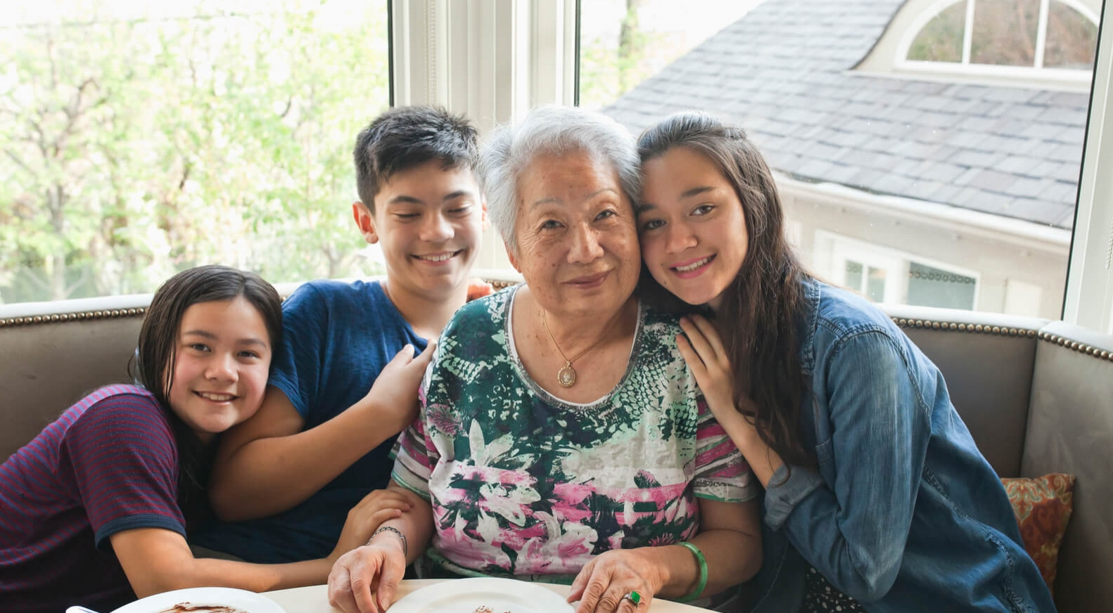 asian family grandchildren having a meal with grandma