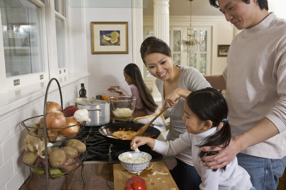 asian family grandchildren having a meal with grandma