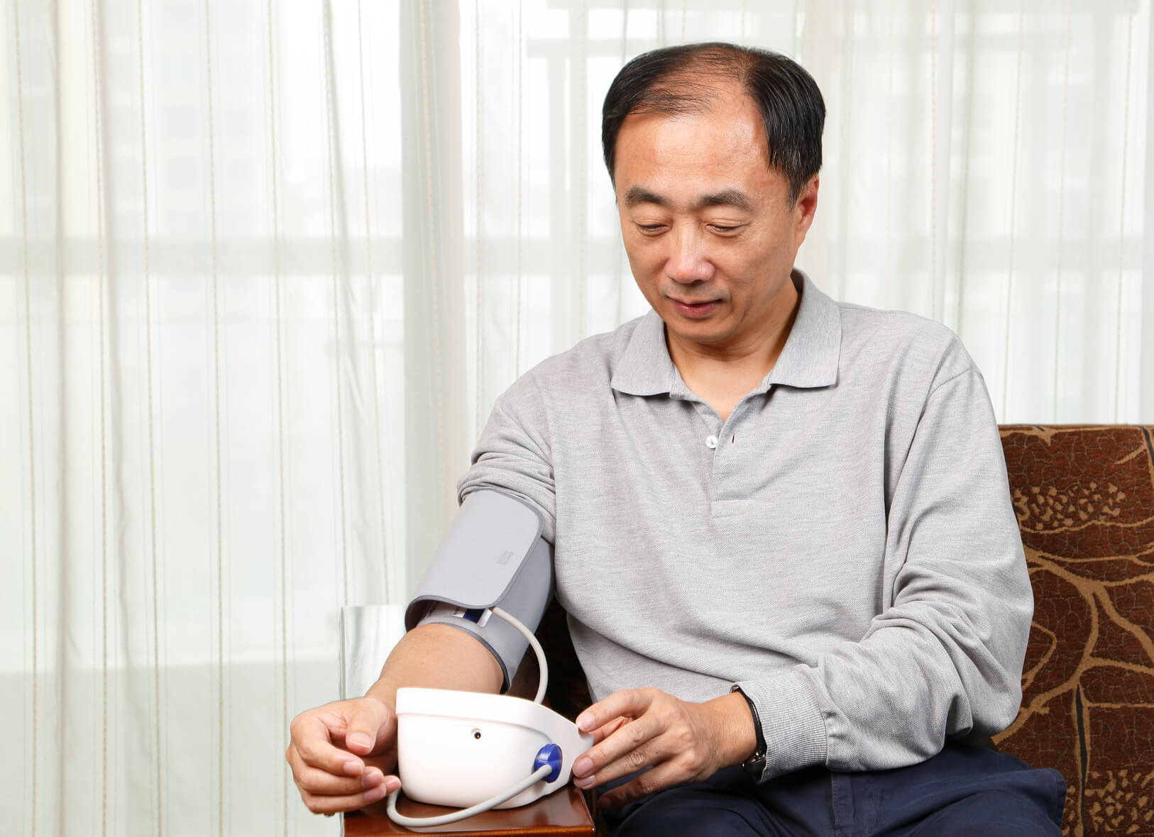 man-taking-blood-pressure