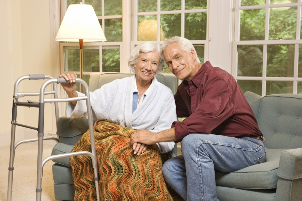 couple sitting together on sofa