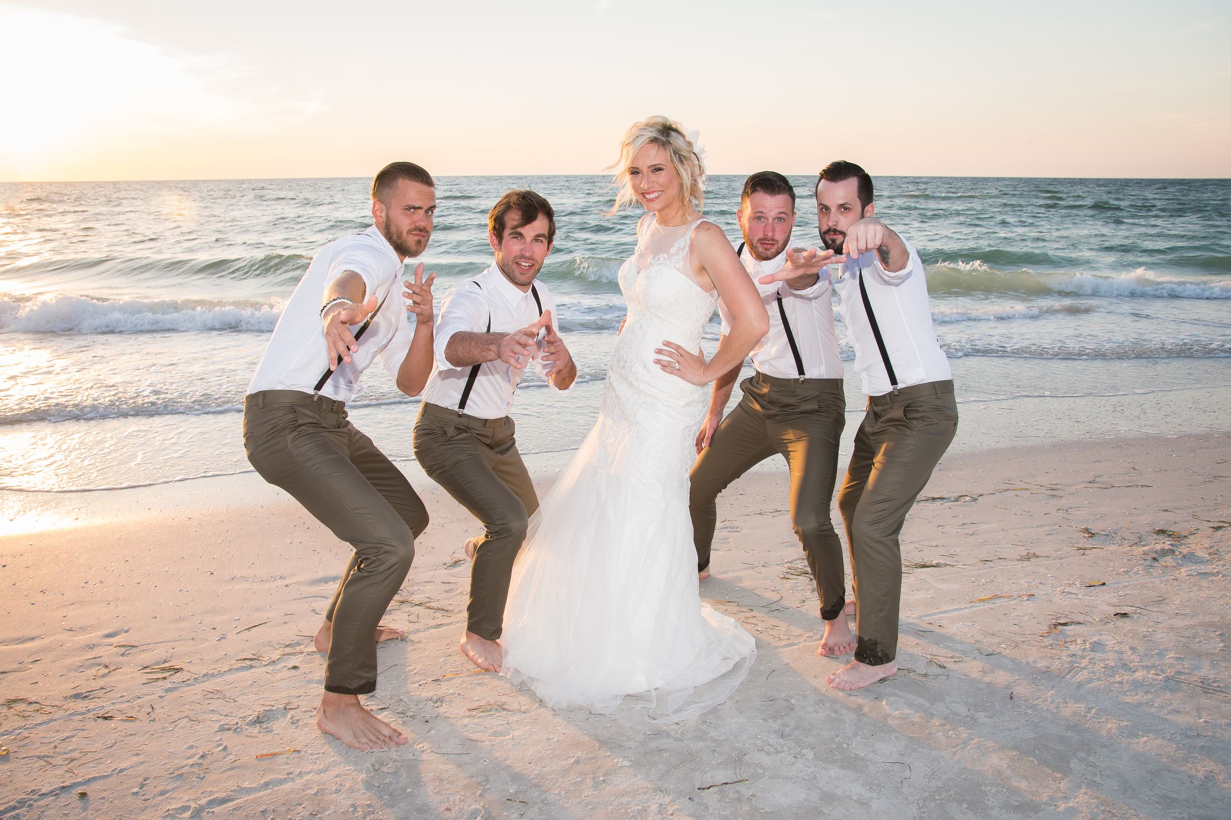 groomsmen and bride pose