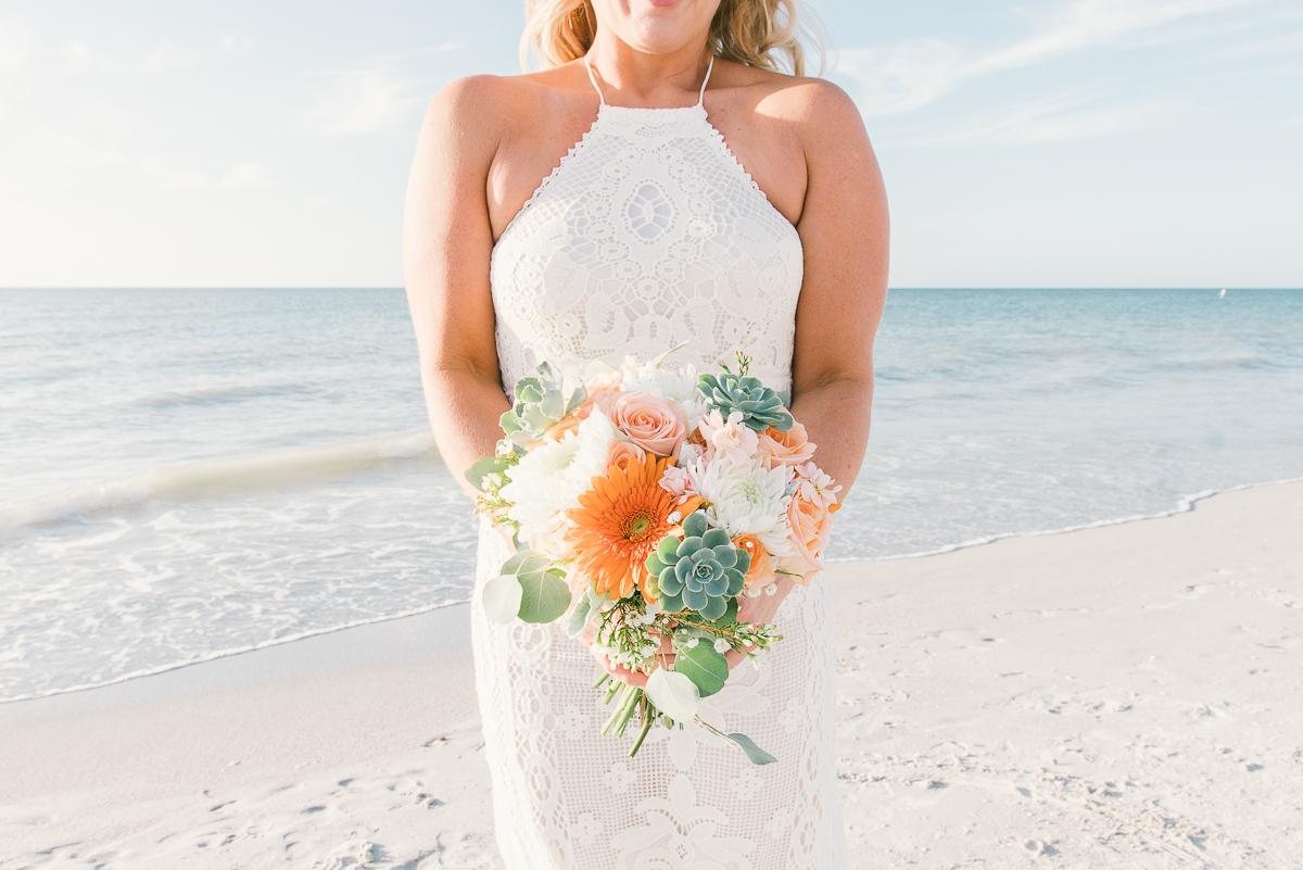 bride-flowers-beach