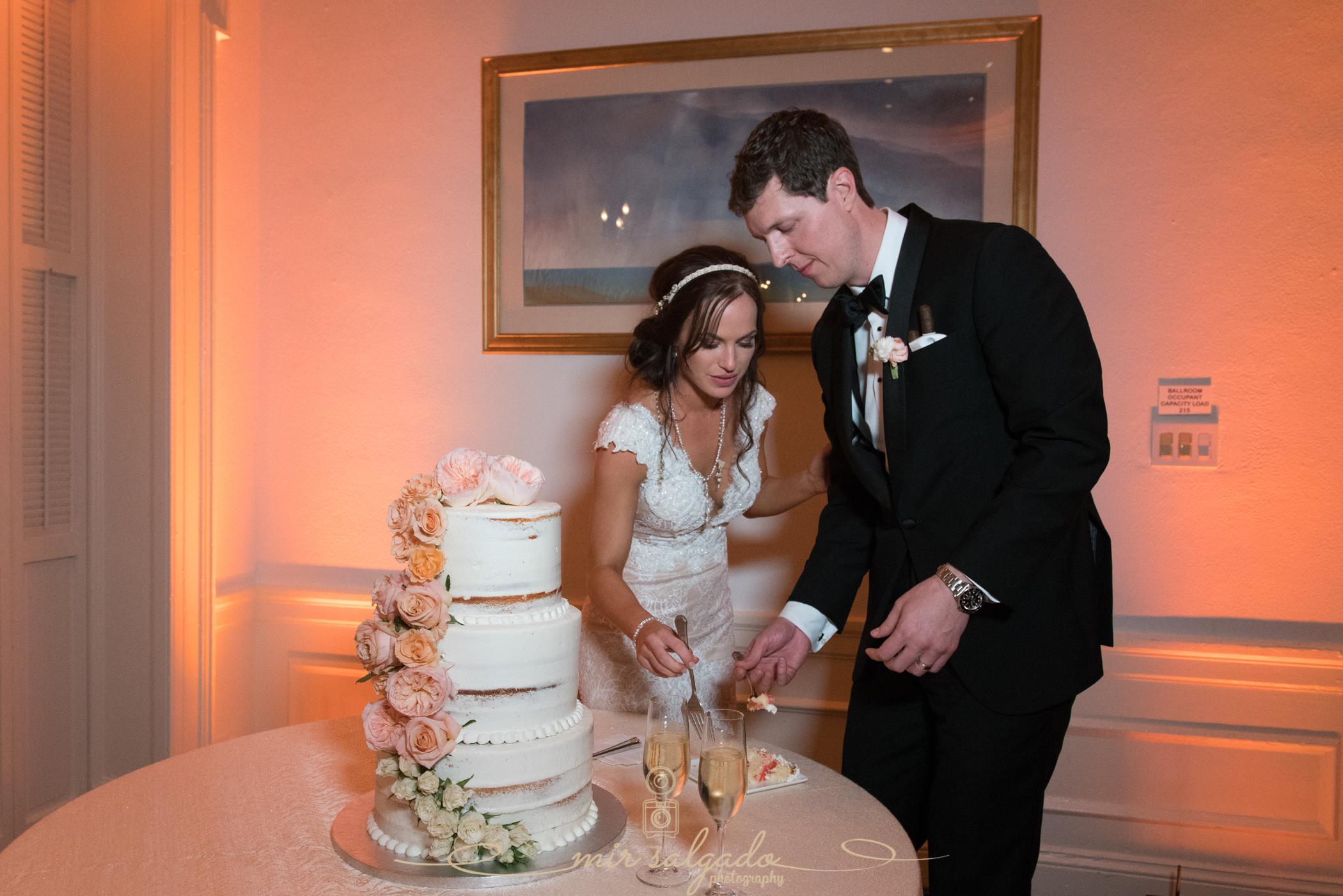 Tampa-yacht-club-wedding, cake-cutting-photo