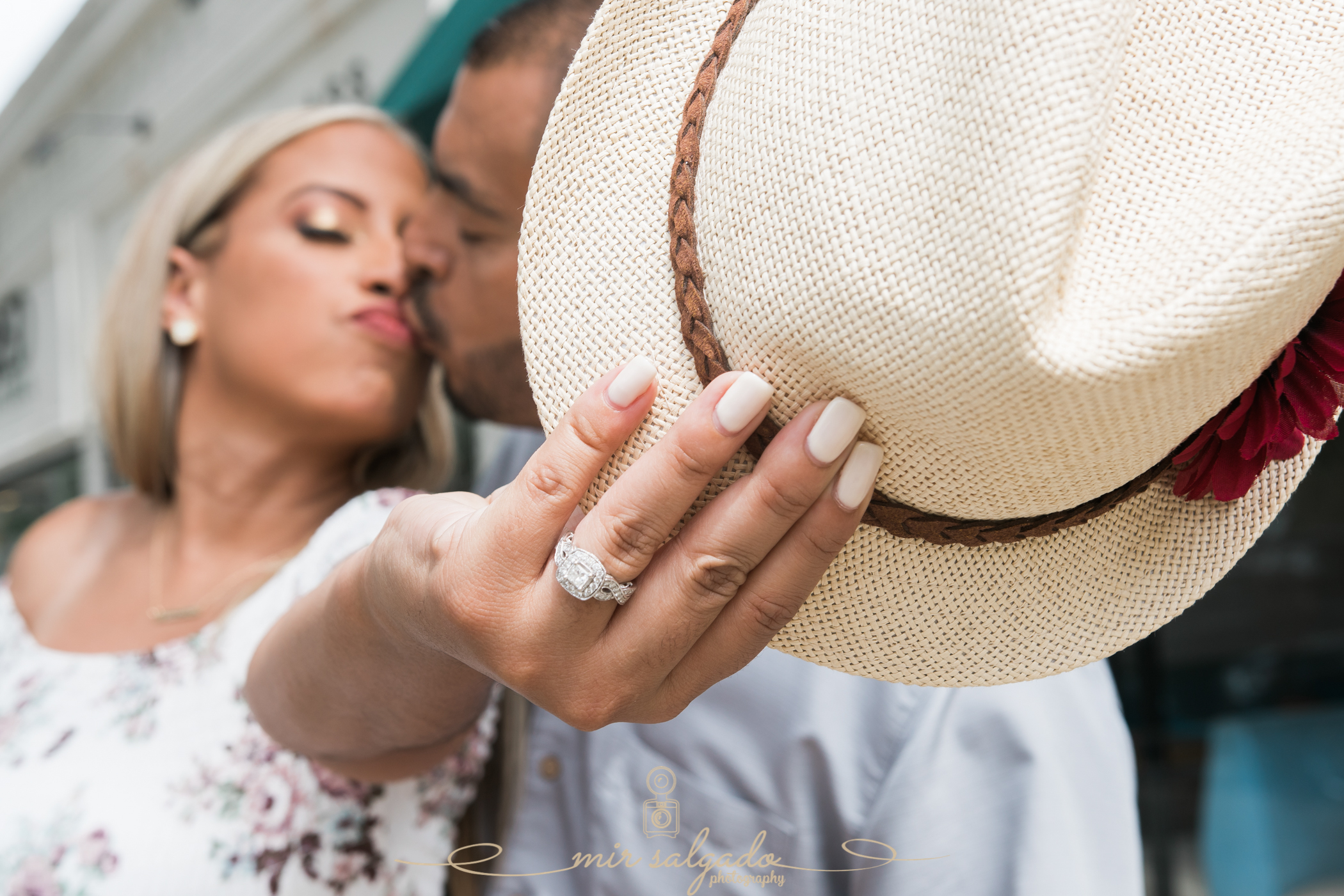 miriam-photography-tampa-st-pete-engagement-session-sunny-floral-dress-hat-diamond-ring-kisses