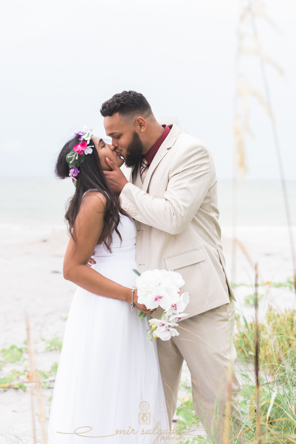 Fort-De-Soto-beach-pictures-flowers-flower-crown-wedding-dress-tan-suit-tampa-photography-kiss-happyiness