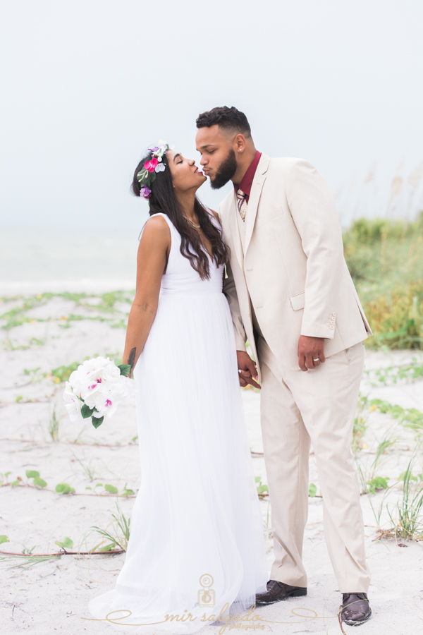 Fort-De-Soto-beach-pictures-flowers-flower-crown-wedding-dress-tan-suit-tampa-photography