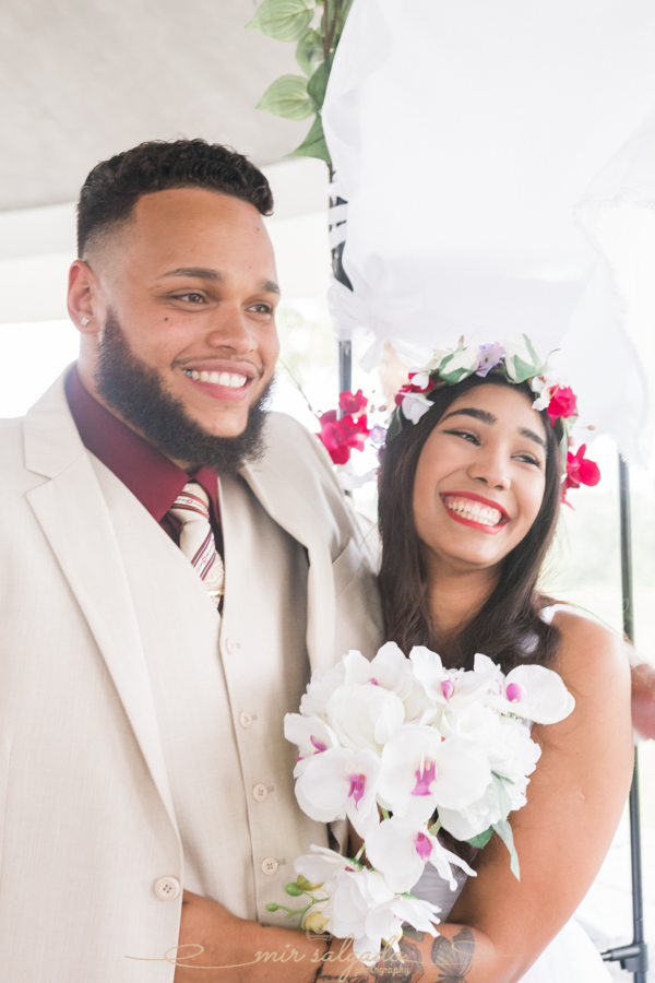 Fort-De-Soto-beach-pictures-flowers-flower-crown-wedding-dress-tan-suit-tampa-photography-happy-photos-happiness-smiles