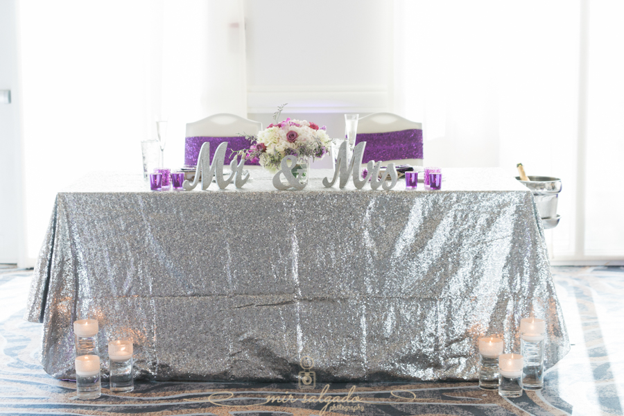 mr-mrs-silver-table-word-sign, silver-table-cloth, purple-candle-holders