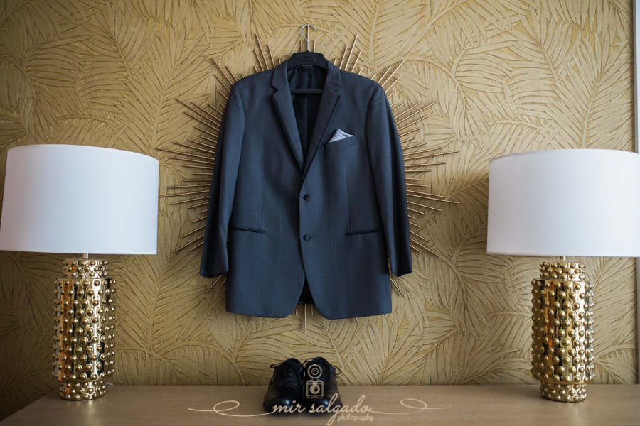 groom-suit-shoes, gold-hotel-lamps, palm-tree-wallpaper