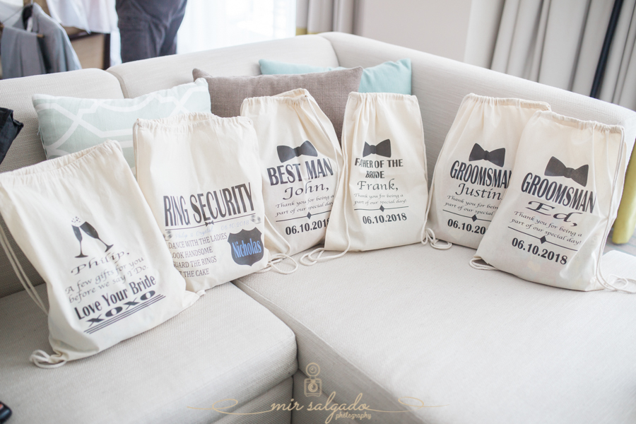 groom-getting-ready, groomsmen-session, Clearwater-beach-session, Tampa-photographer, wedding-drawstring-bags
