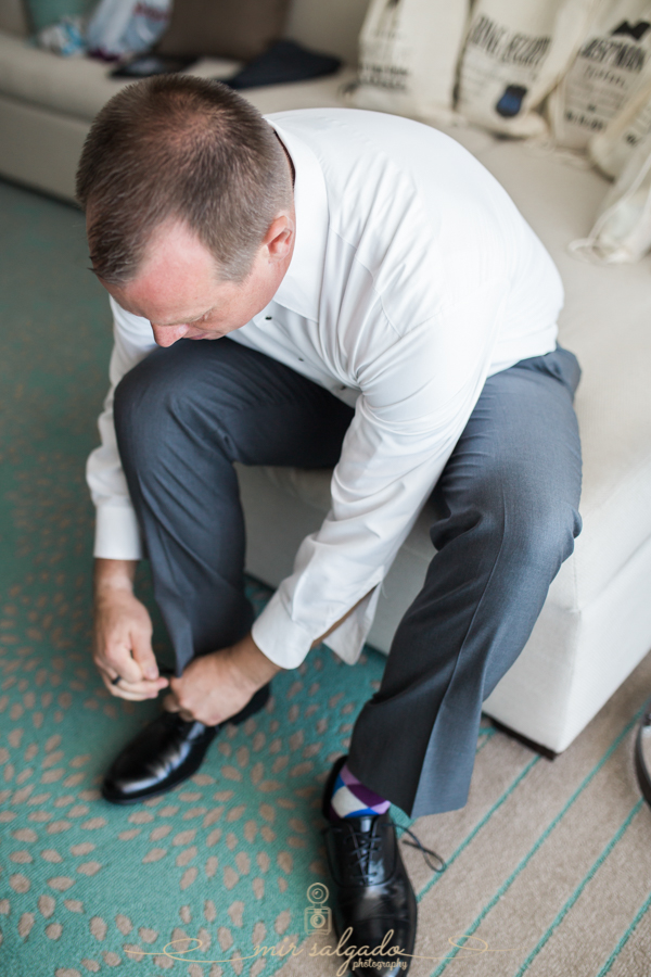 groom-getting-ready, tying-shoes, Tampa-wedding-photographer