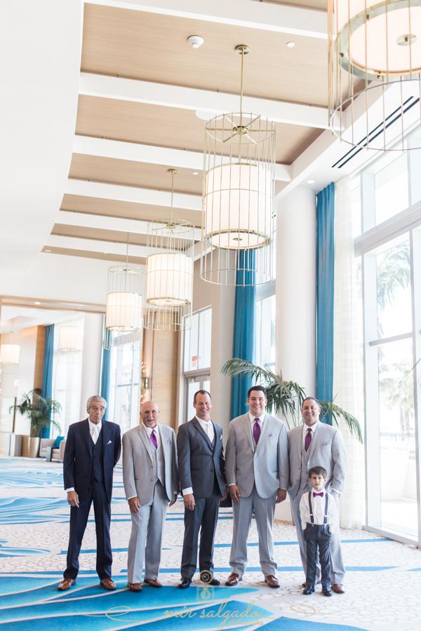 groomsmen-session, ceiling-big-lights, hyatt-hotel-hallway