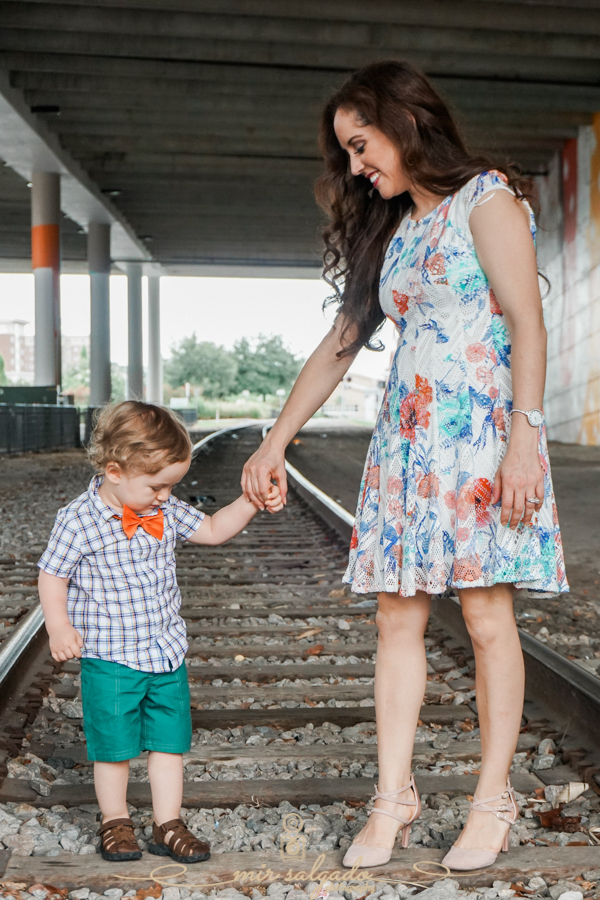 Train-tracks, Glazer-Children's-Museum, lovely-family-session, happy-two-year-old, Mom-baby-moment