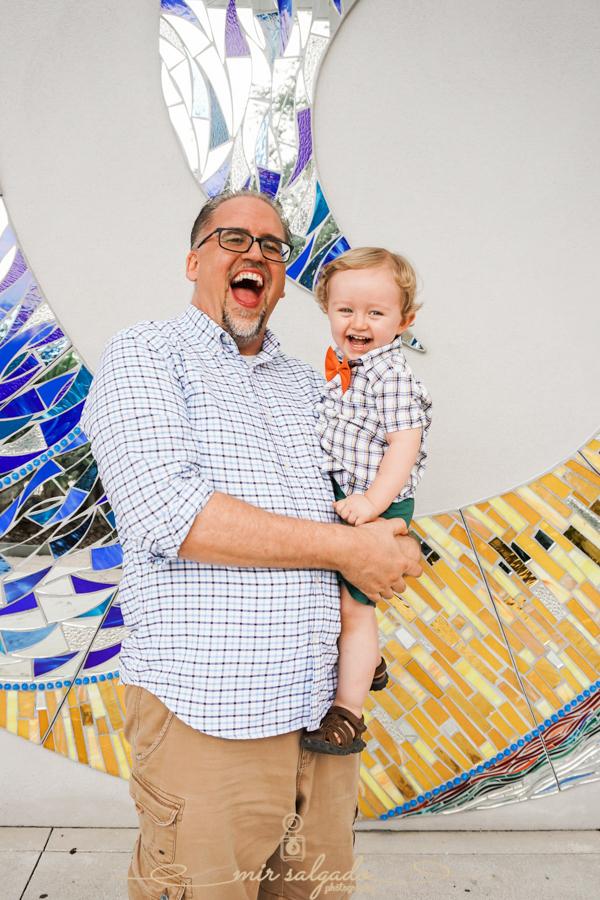 happy-dad-son, giggly-laughs, baby-boy, orange-bowtie, plaid-dress-shirts