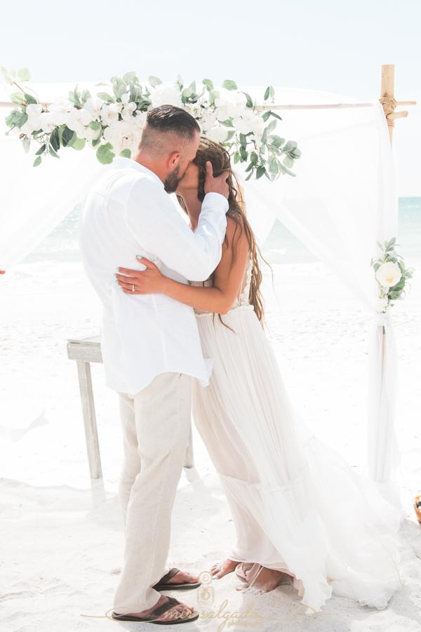 First-kiss-at-the-beach, beach-wedding, Florida-photographer
