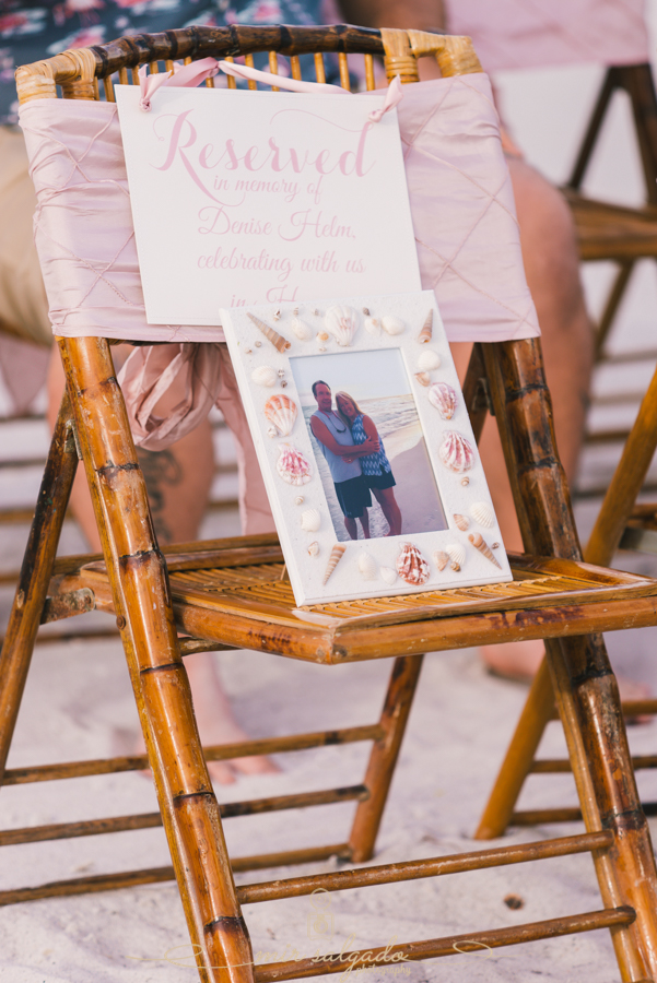 "An empty seat reserved for the Groom's mother who recently passed away.   ""We knew her favorite place was the ocean. So there wasn't a better place to do it, to have her there in spirit."""