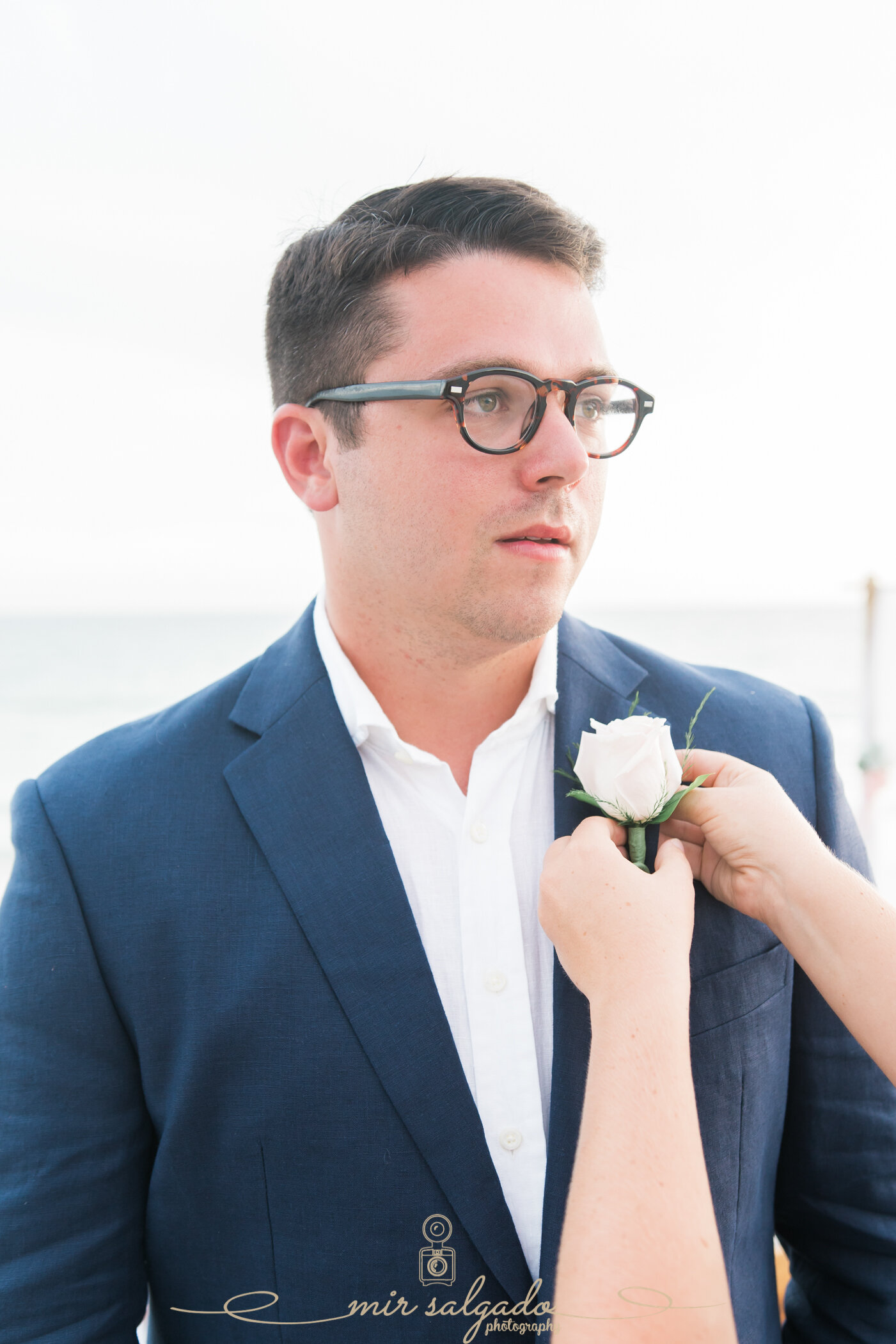 groom-attire, groom-outfit, groom-boutonnière, groom-getting-ready-for-wedding