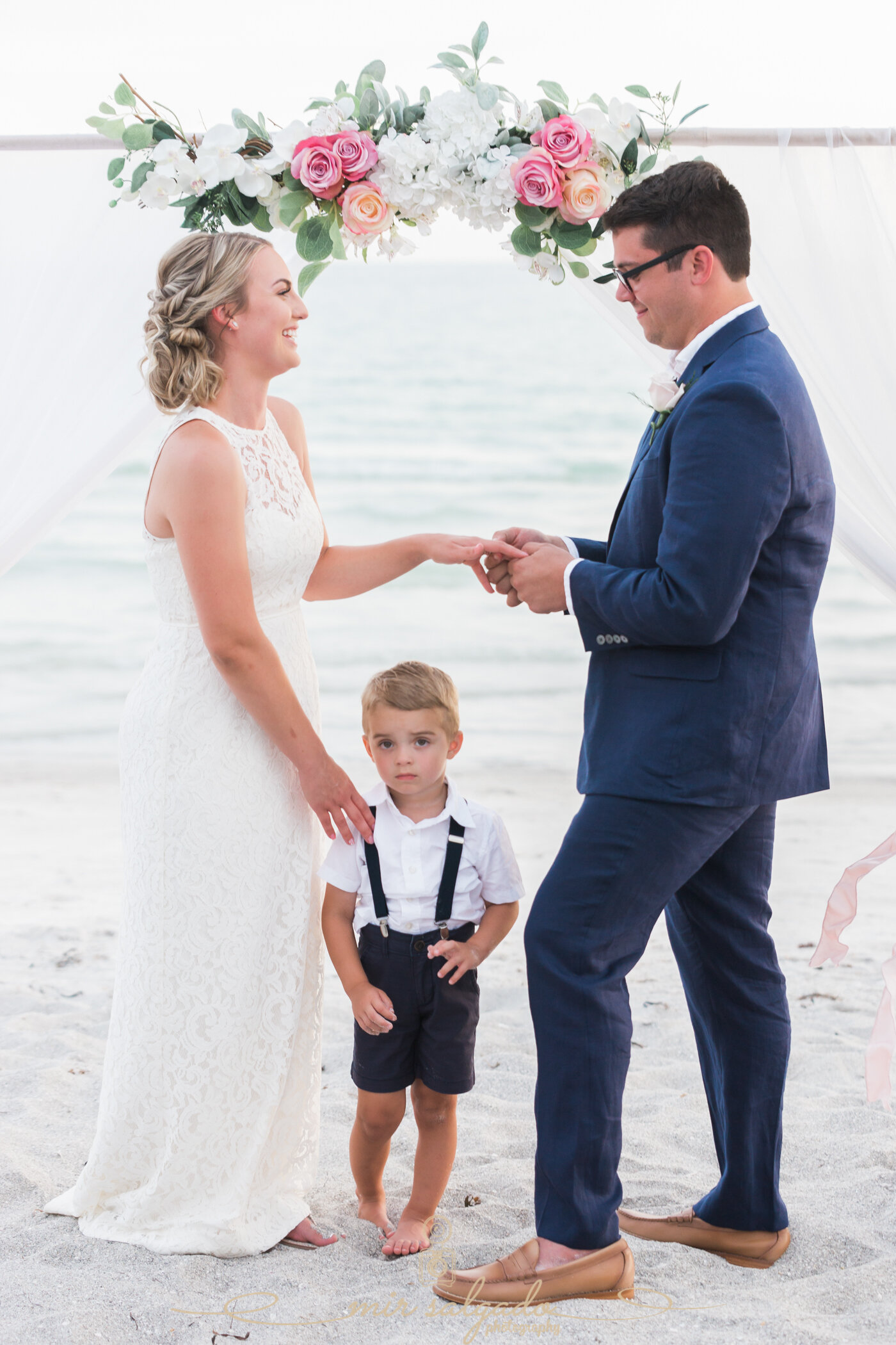 wedding-vows, beach-wedding-ceremony, resort-venue, bride-wedding-dress, groom-outfit