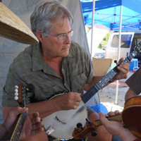Retired professor Frank Metcalf drives from Vancouver, BC to jam at the Stickerville campground