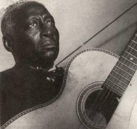 "Huddie ""Lead Belly"" Ledbetter, c. 1930-1940, discovered by John Lomax"