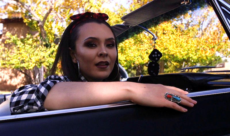Olivia Romo cruising in a 1962 Chevy Impala