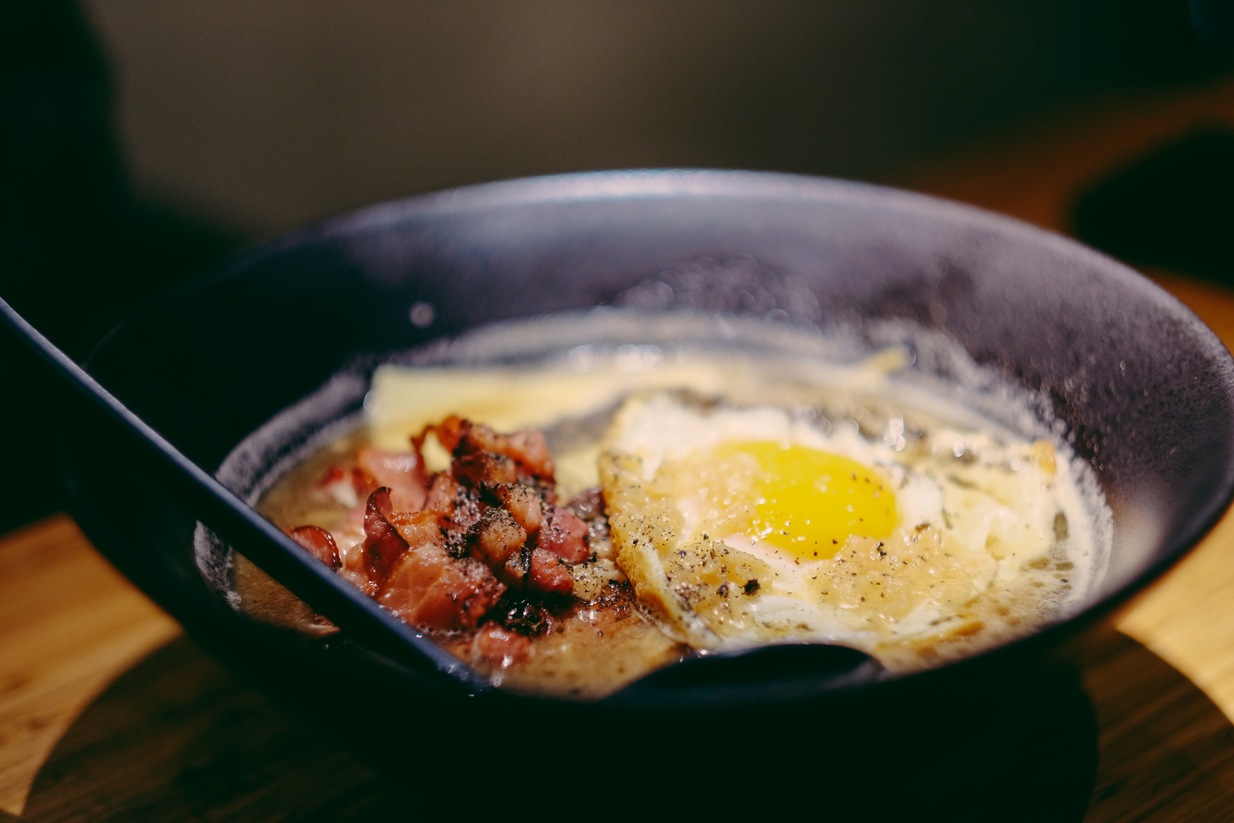 F.U. Ramen at Wrong Ramen. A liquified breakfast; with black pepper spam, bacon, cheese and fried egg in broth
