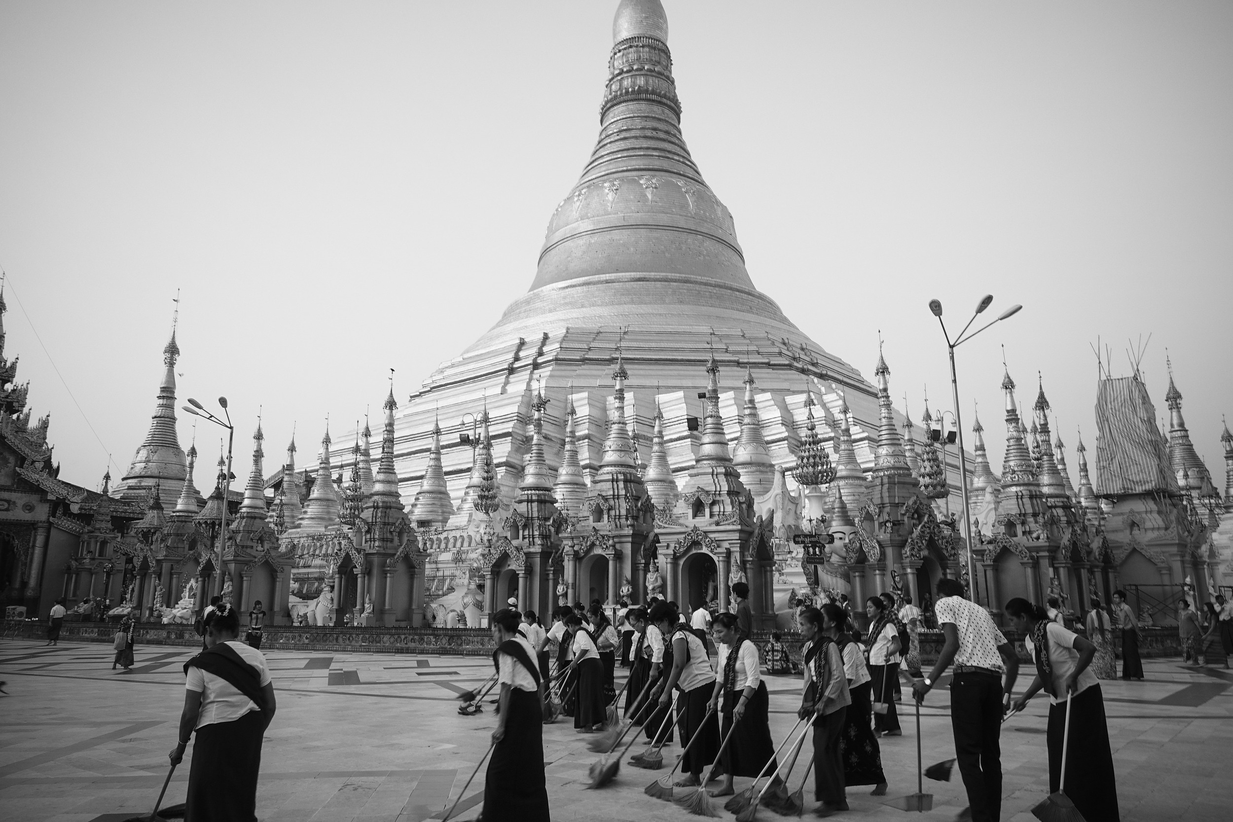 Ordinary folk pick up broom and dustpan and form a line of sweepers each morning at the temple forecourt.