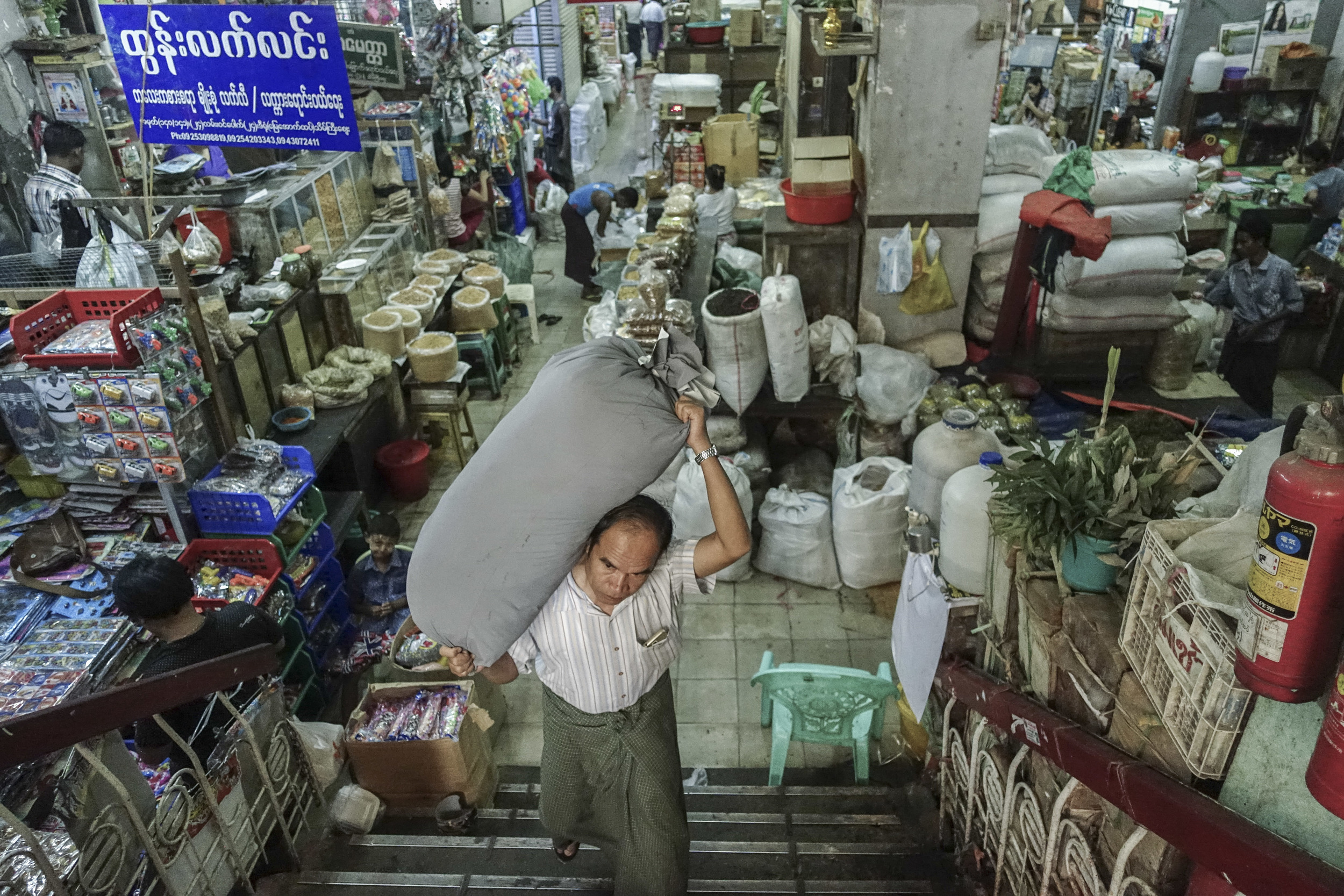 A man walks up the steps at the Thein Gyi Zay wholesale market.
