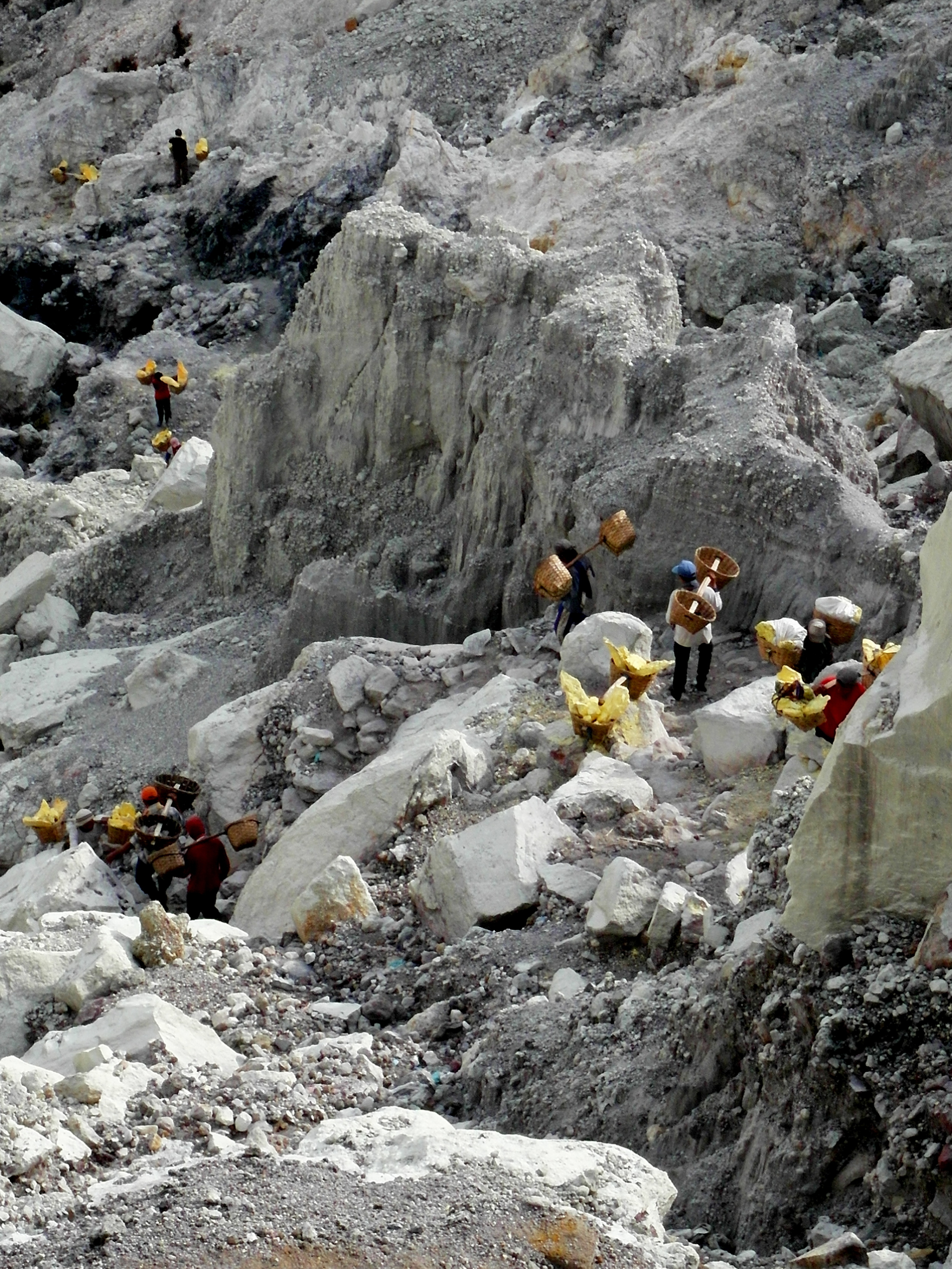 he miners of Kawah Ijen going about their daily routine.
