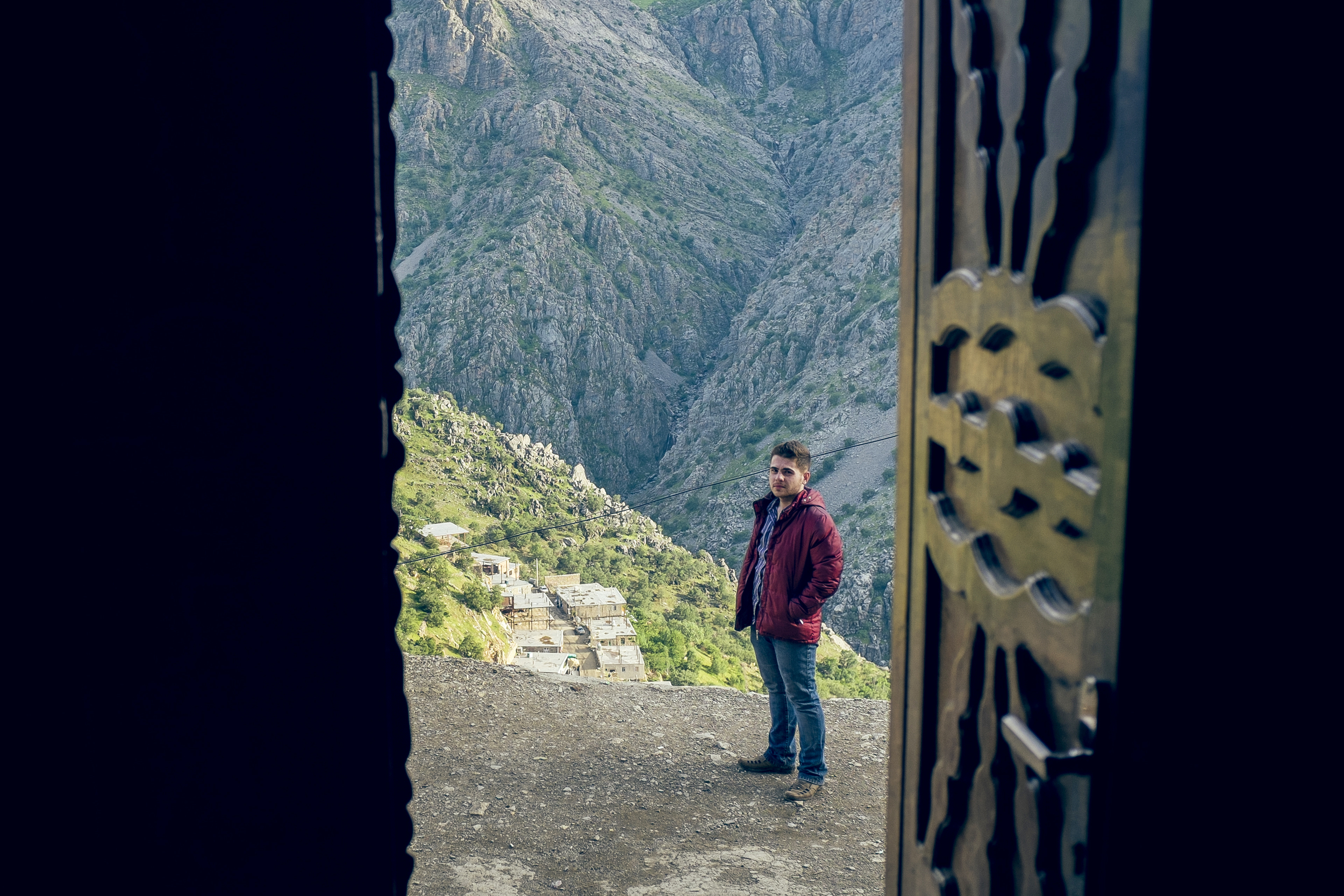 Arshad, a dear friend who hosted and showed me around, with the cliffs of Hawraman Takht at the background.