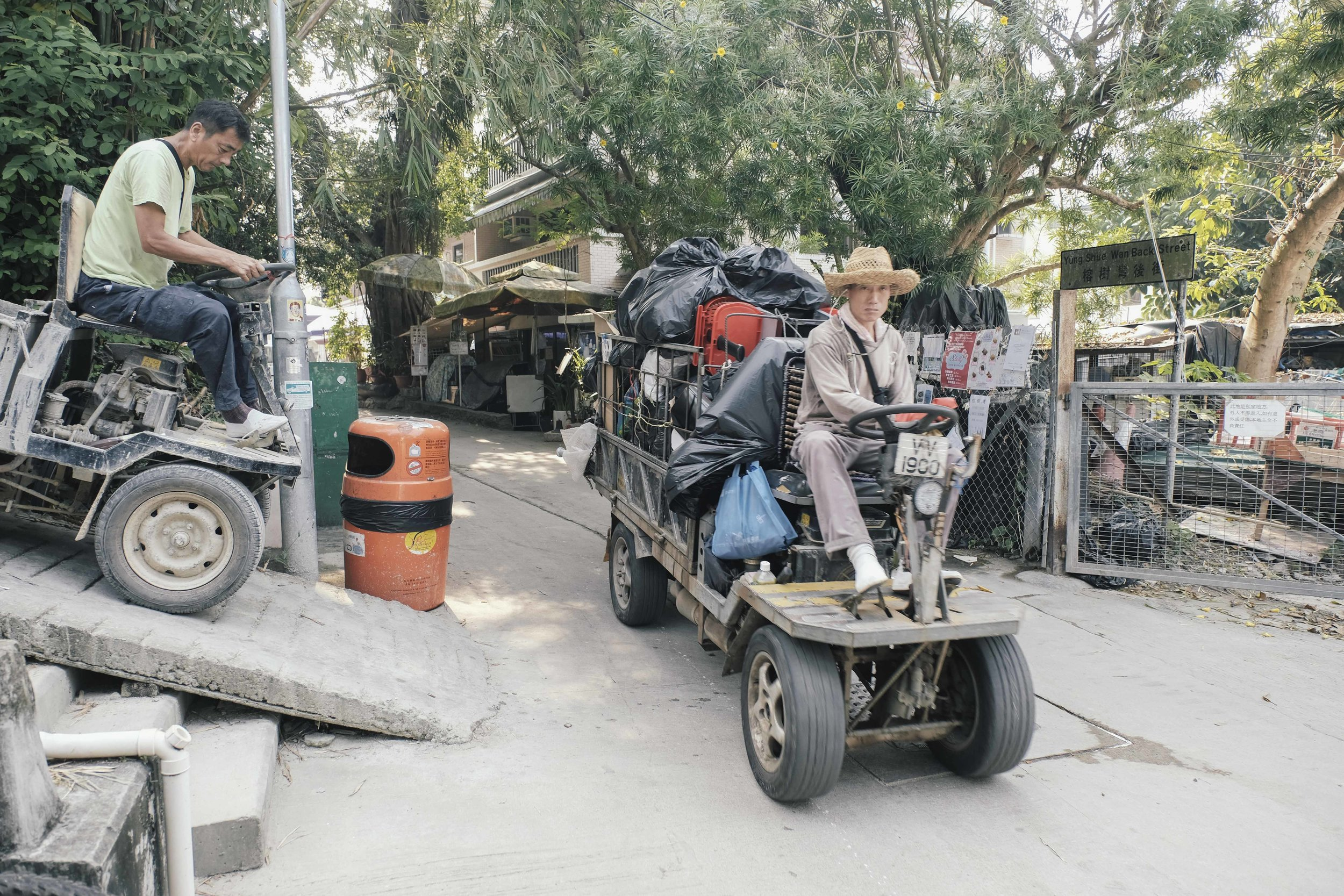 These tiny tractors used to haul building materials and trash are the only form of motorised transport allowed.
