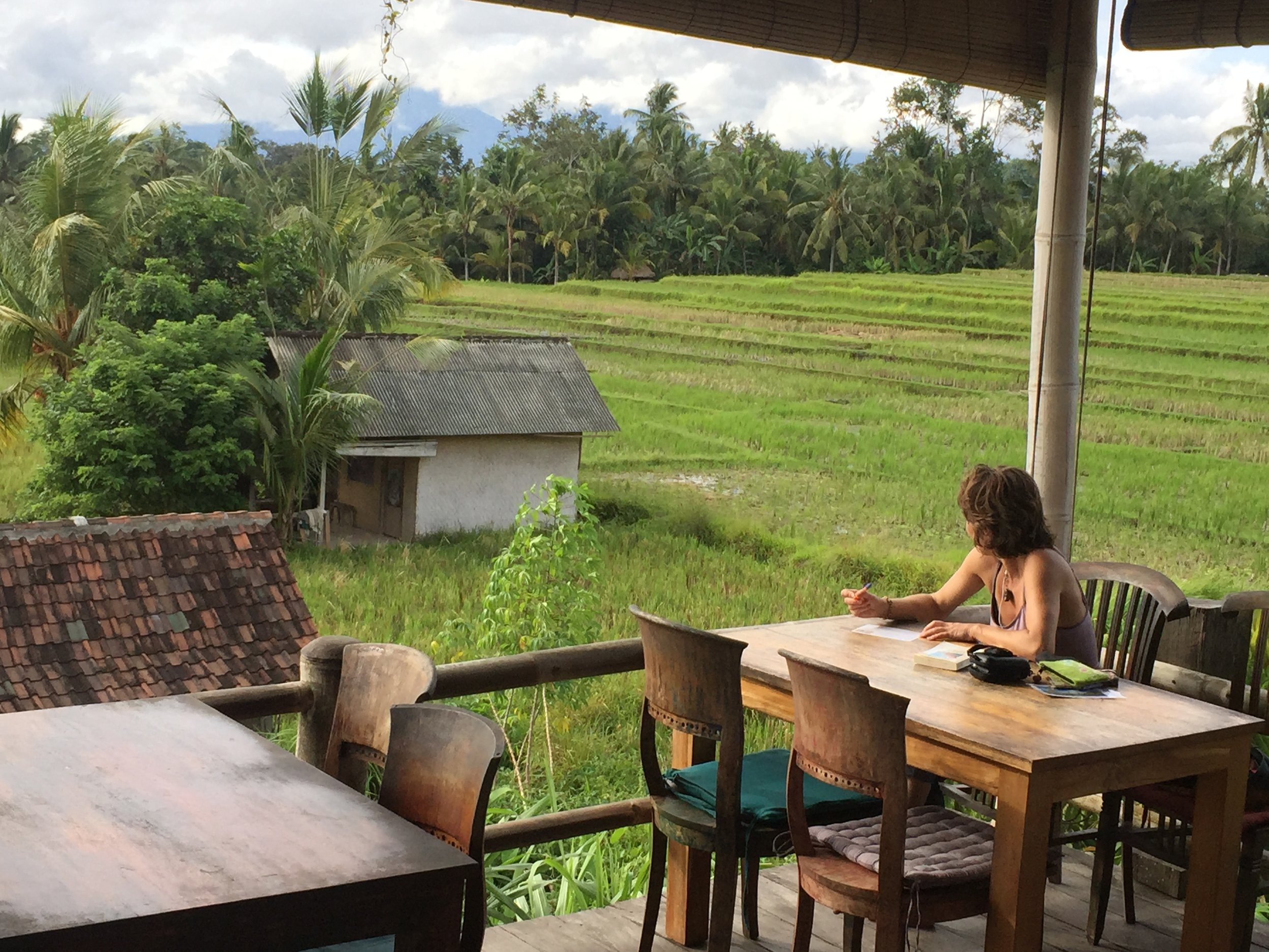 A woman looks out from Sari Organik, a restaurant situated in a restful corner of Ubud.