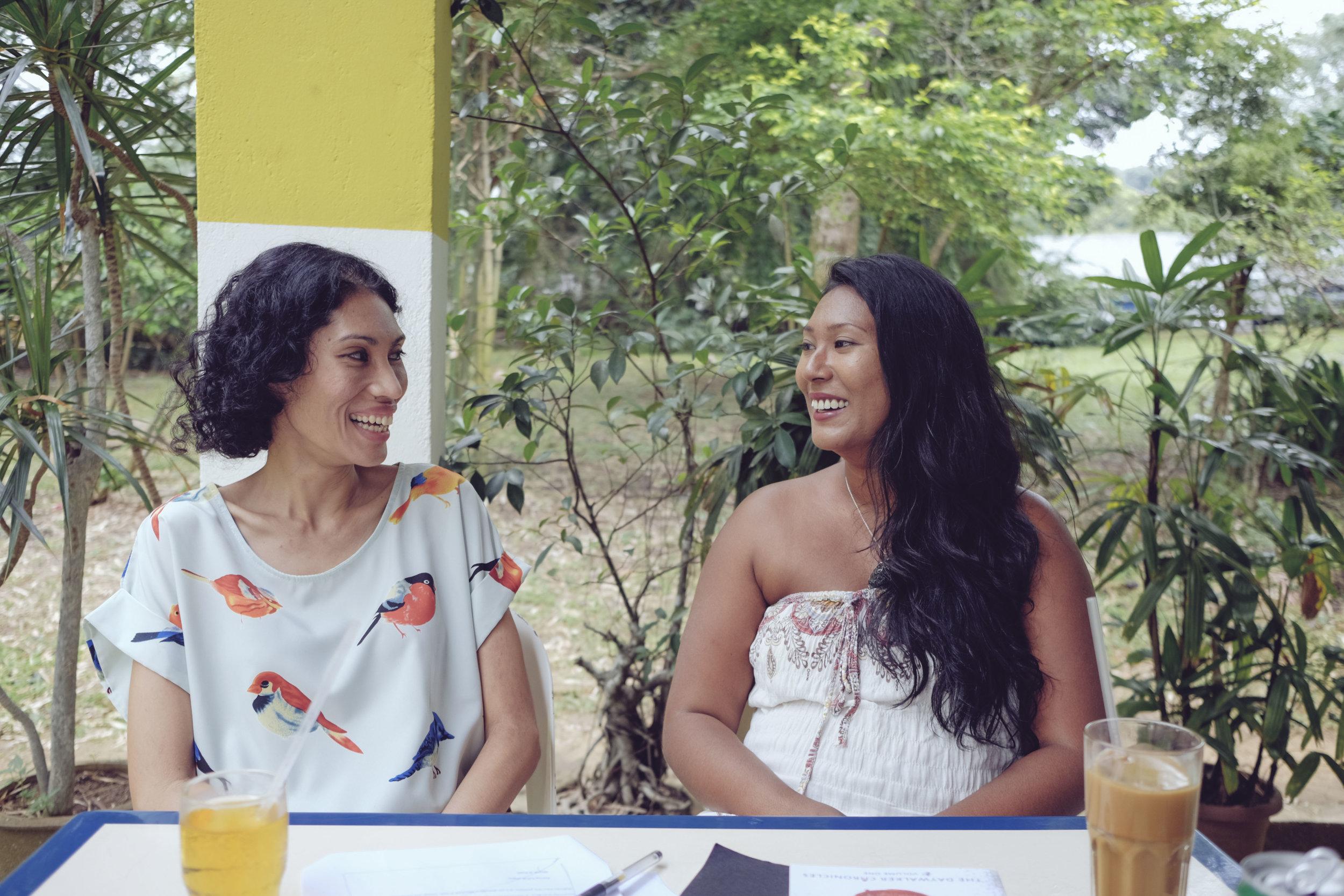 Melissa De Silva (L) and Samantha De Silva (R) enjoying a chat at Colbar in Portsdown Road
