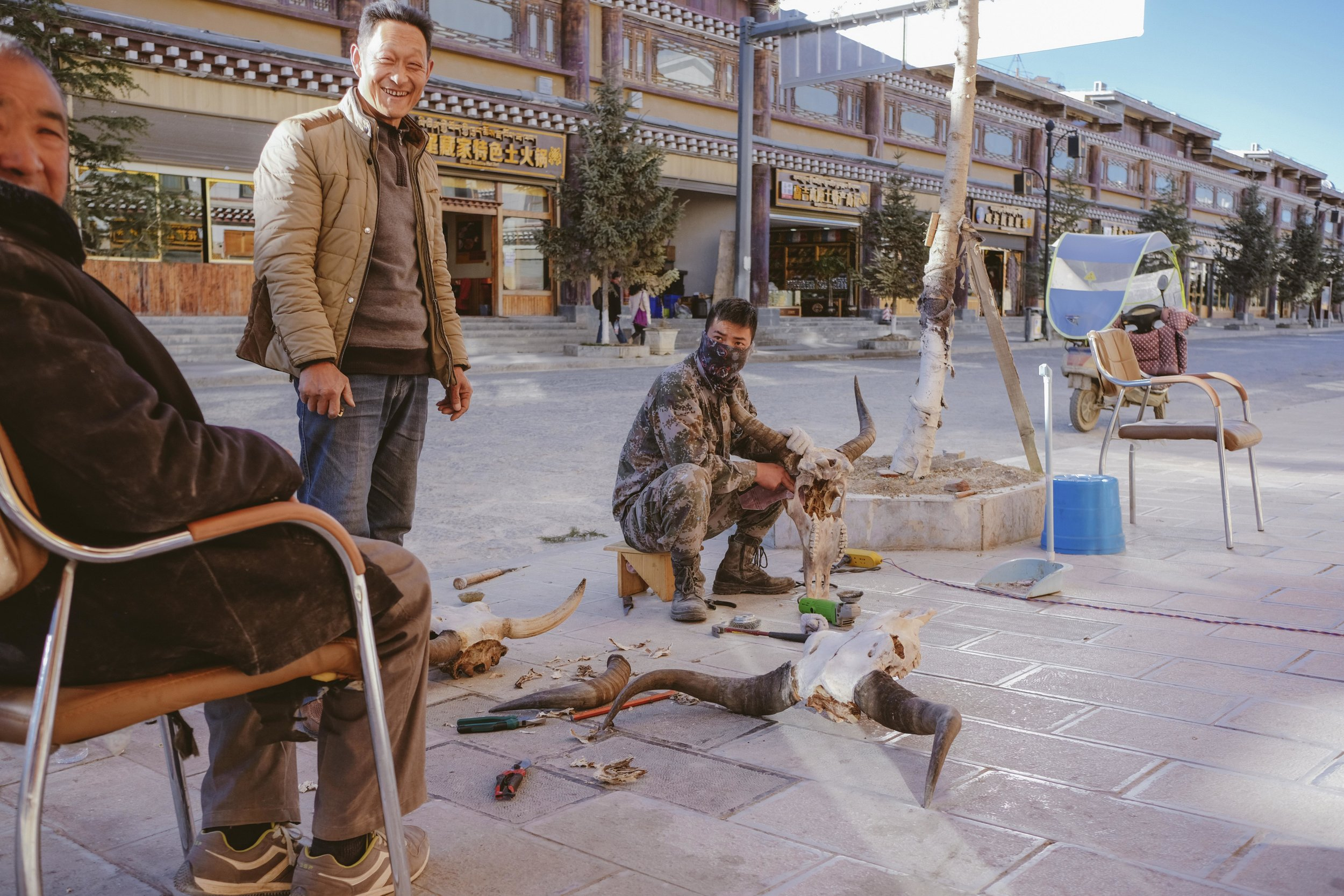 There's still a market for yak heads as ceremonial items, and what better place to polish them clean from gristle then out on the sidewalk.