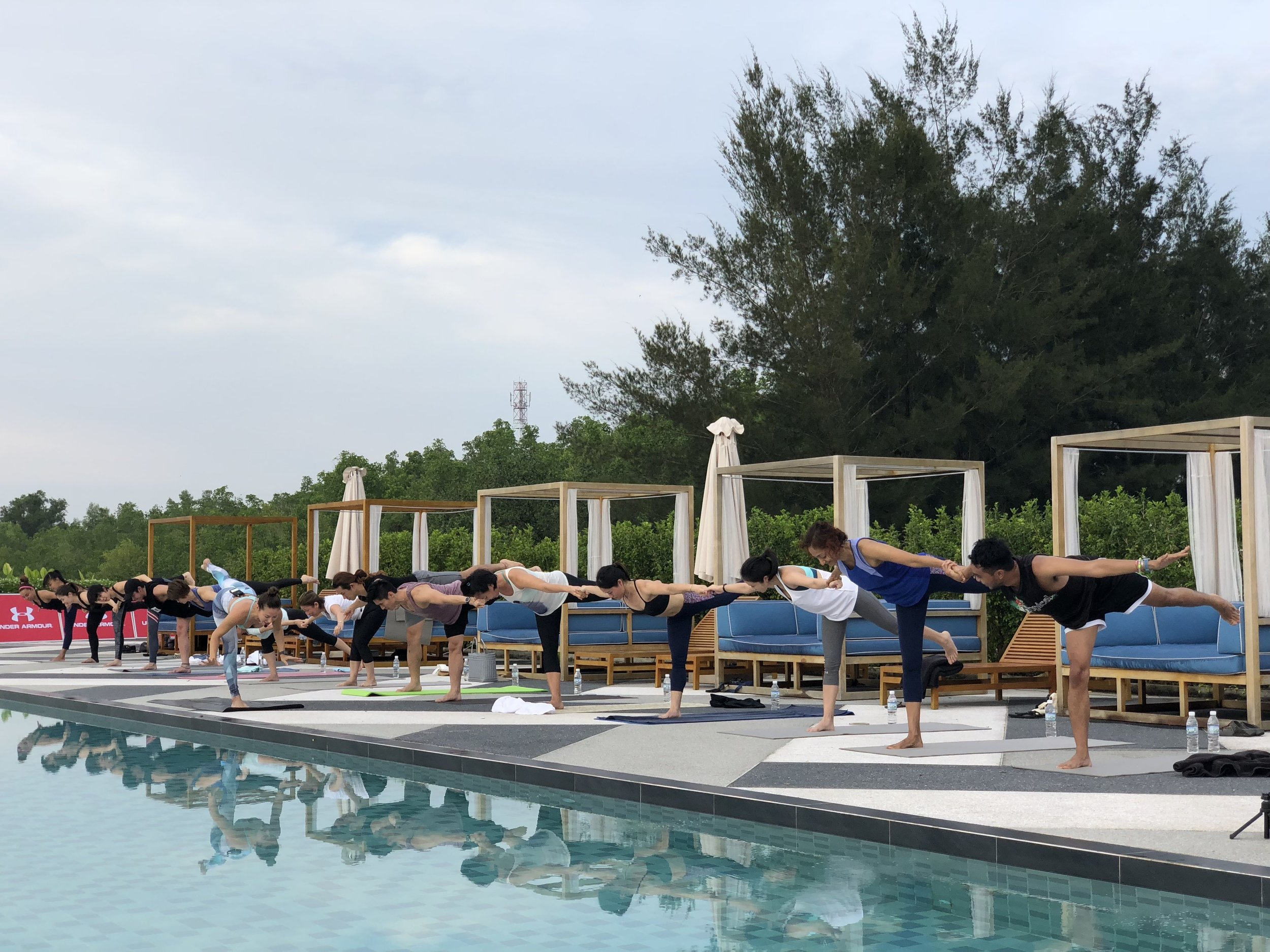 Denise Keller encouraging yogis to hold hands and keep the peace. Photo: Rainforest Fringe Festival