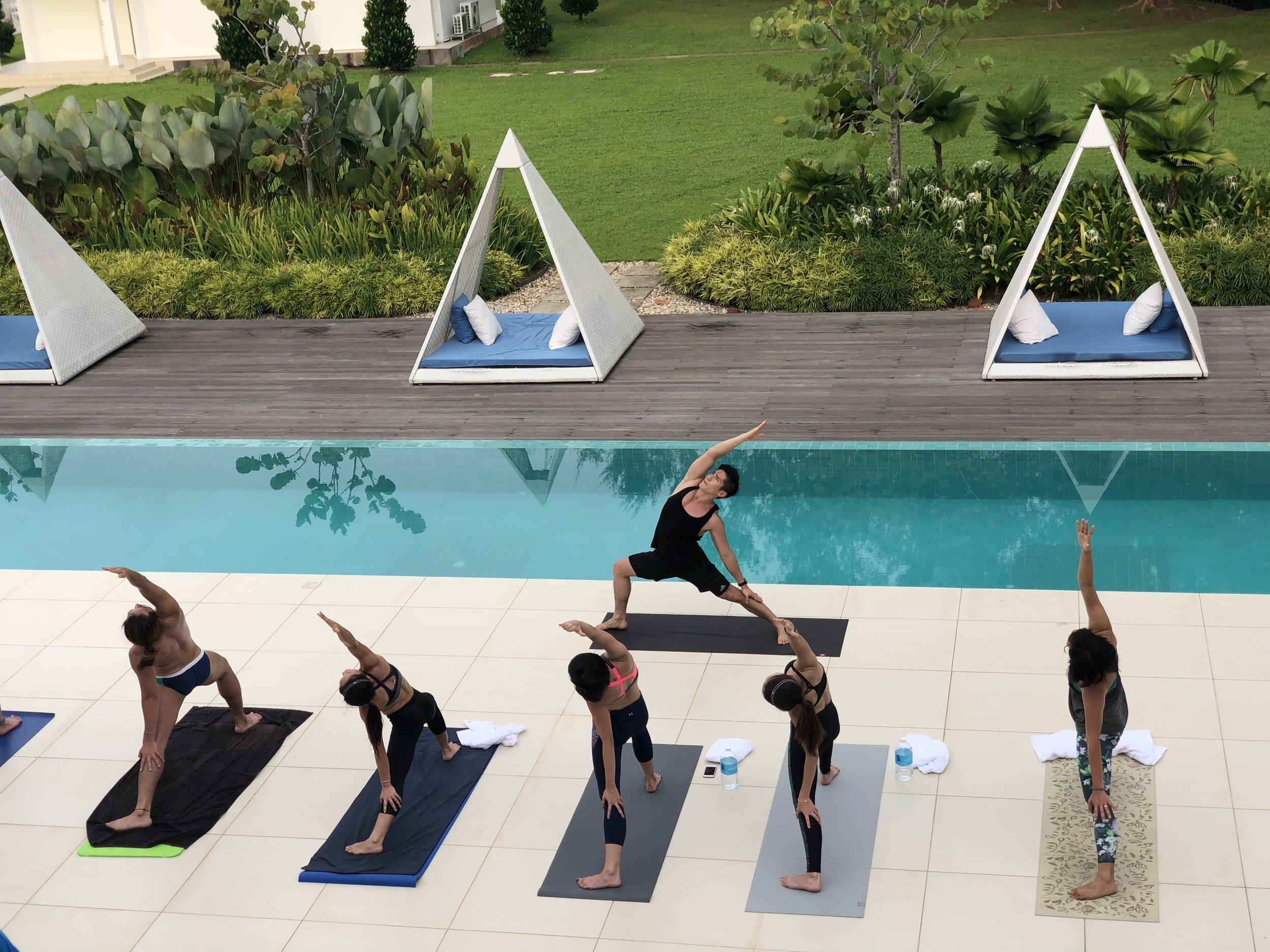 Hendri Take and yogis channelling their inner warriors. Photo: Rainforest Fringe Festival