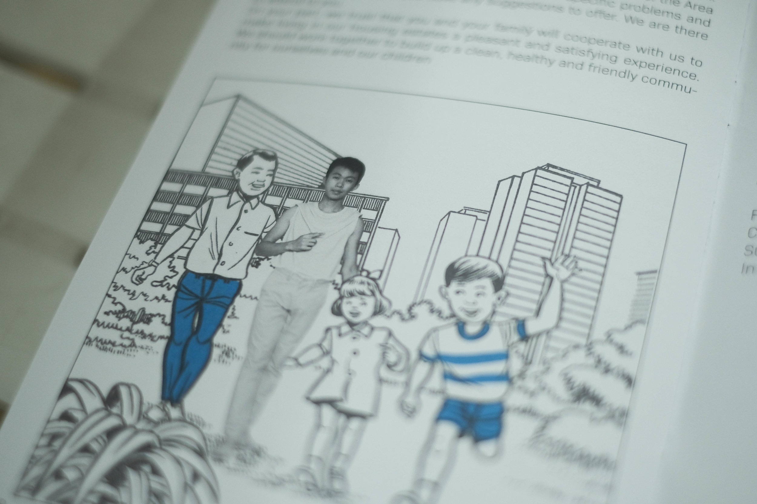 Sean Cham, the creator of First Storeys, created a handbook in which he features prominently. The handbook gaily prepares residents for the process of resettlement.