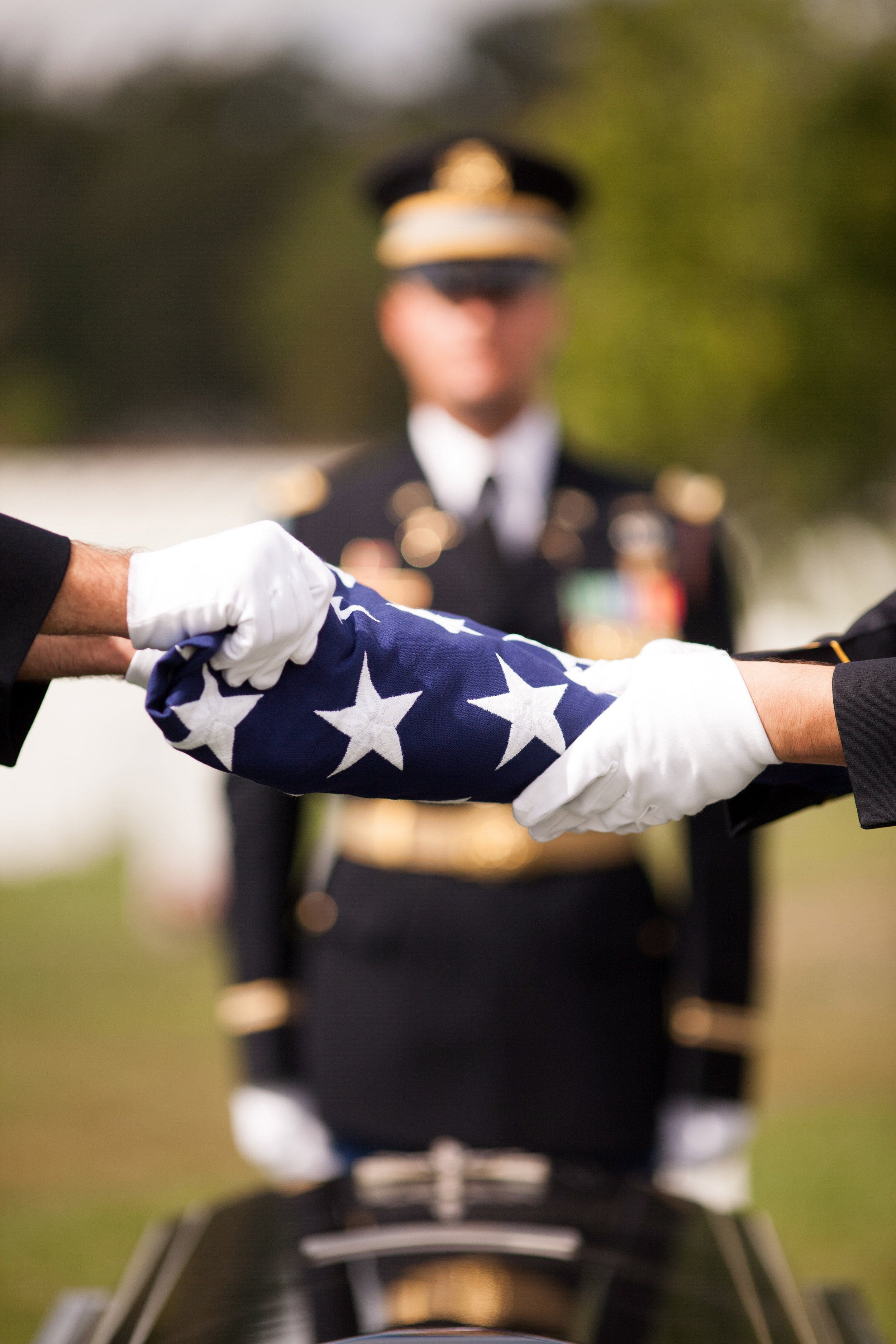 WASHINGTON D.C., September 27, 2017-- Two soldiers finish folding the flag that draped the casket of this fallen brother-in-arms. Of all the military ceremonies I have witnessed in my lifetime, none have the carefulness and precision that is displayed so profoundly in these burials.  Photo by Taylor Mickal