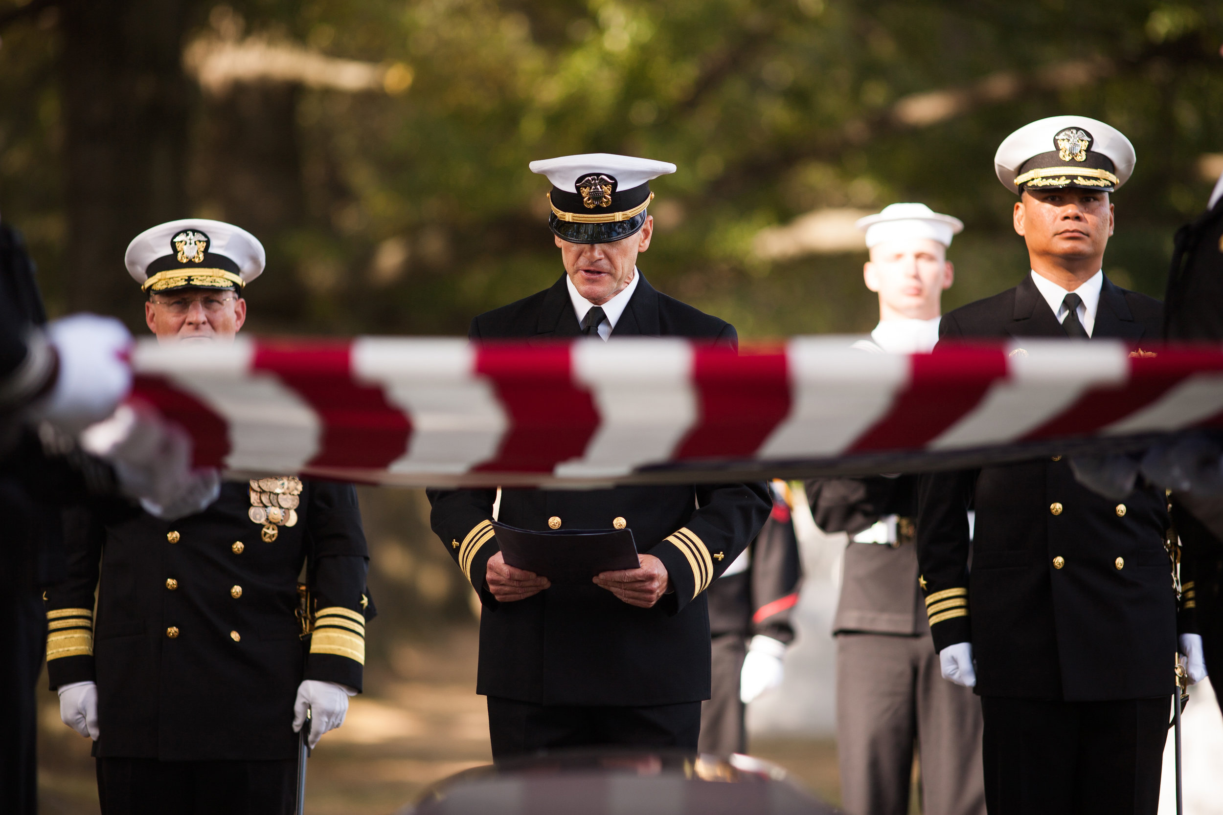 WASHINGTON D.C., October 05, 2017-- The Chaplain gives his service as the funeral commences. There is a strain in his voice as he pushes through to deliver, his words falling softly on those listening.  Photo by Taylor Mickal