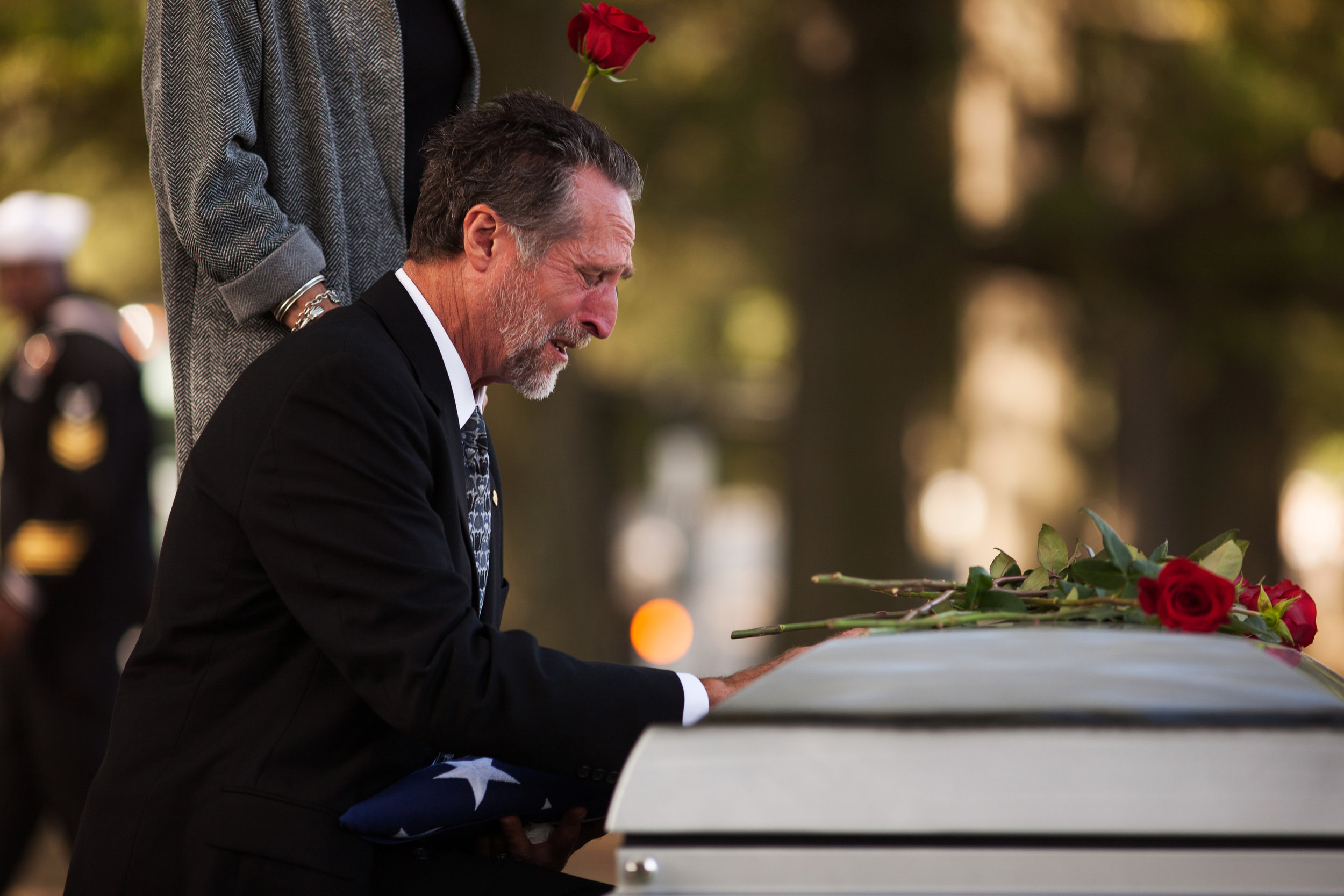 WASHINGTON D.C., October 05, 2017-- Kevin's father made several returns to the casket, unable to leave his son's side. On the third return, he fell to his knees and wept-- the agony of the loss to heavy to bear in the moment.  Photo by Taylor Mickal