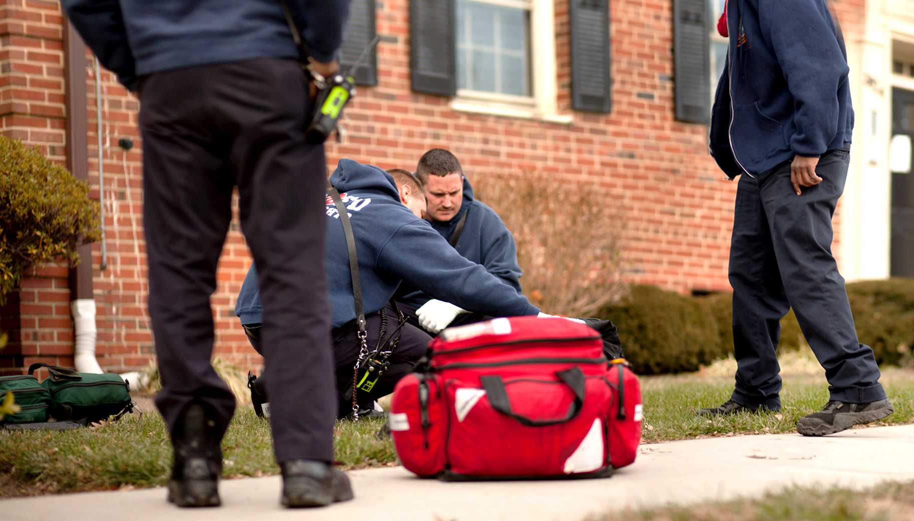 WASHINGTON D.C., December 22nd, 2017-- Firefighters Mastri and John Doe assess a patient unconscious on the grass outside of an apartment.  Photo by Taylor Mickal.