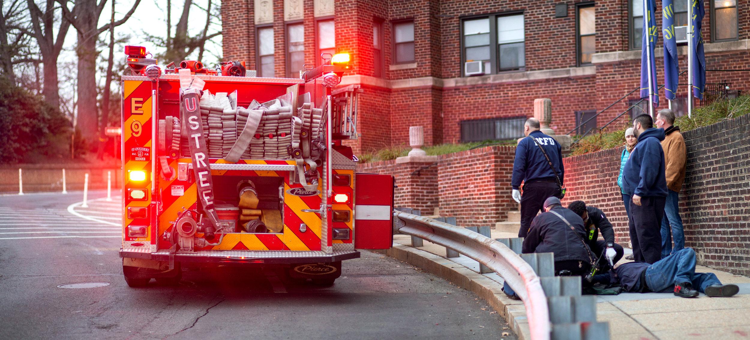 WASHINGTON D.C., April 7th, 2018--Lieutenant Zelonis, Sergeant Ward, Technician Baldwin, Probationer Arnold work to treat a patient outside an apartment complex in NorthWest DC.  Photo by Taylor Mickal.