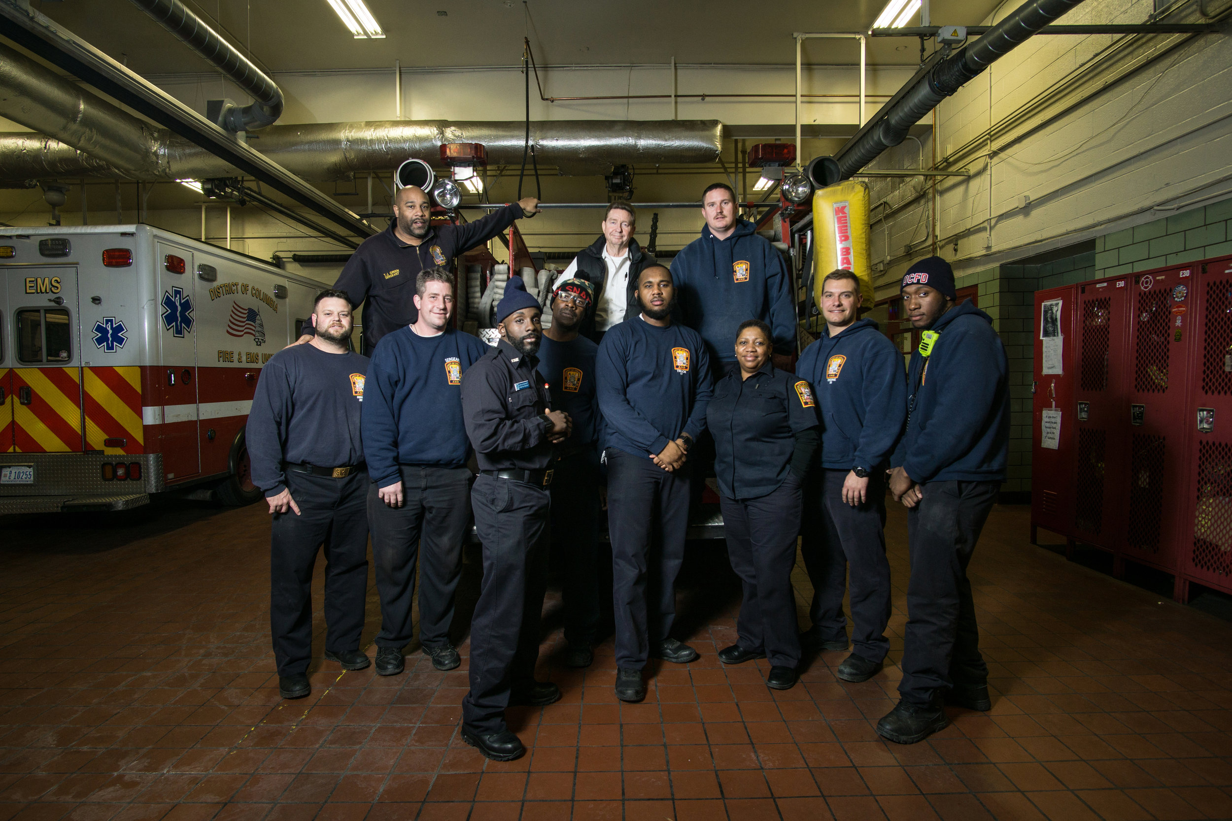 WASHINGTON D.C., December 22nd, 2017-- Engine 30 and Truck 17 stand together for a group portrait in their Station.  Photo by Taylor Mickal.