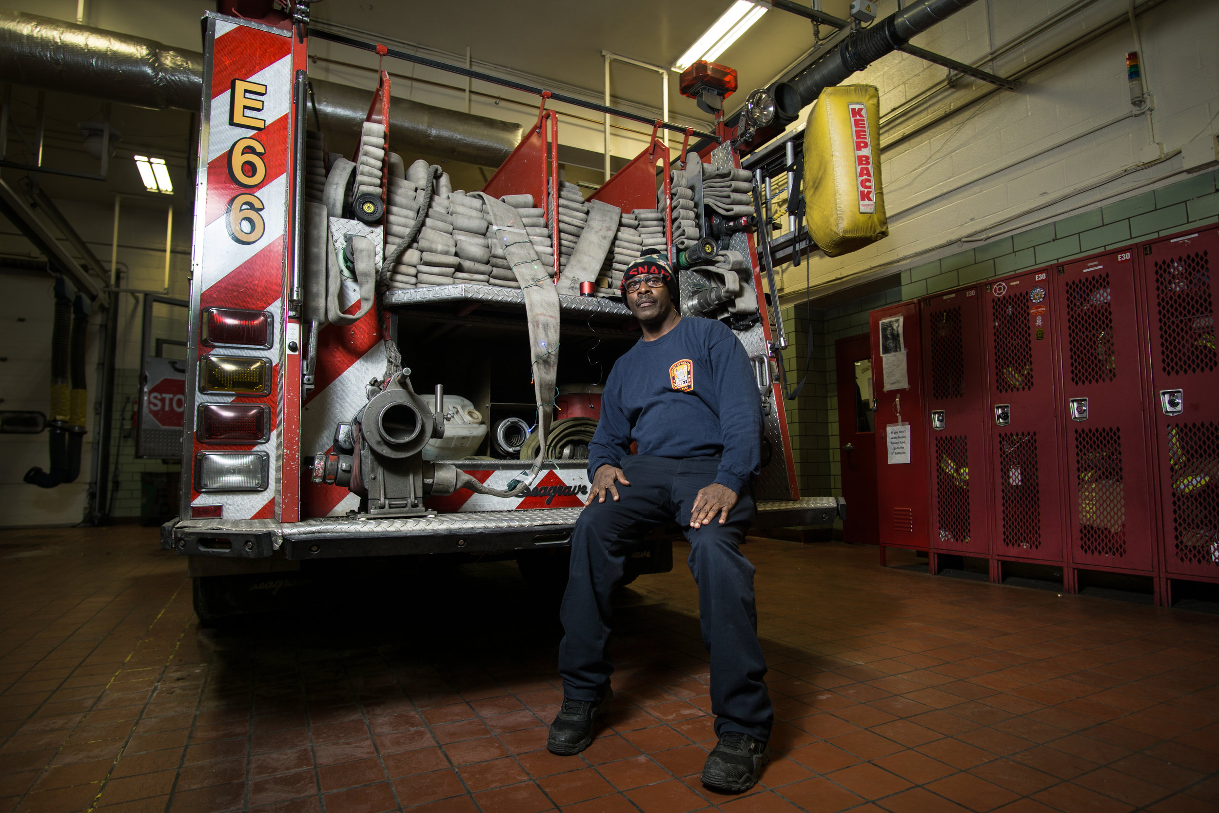 WASHINGTON D.C., December 22nd, 2017-- Technician Meatloaf sits on the rear of his Engine.  Photo by Taylor Mickal.