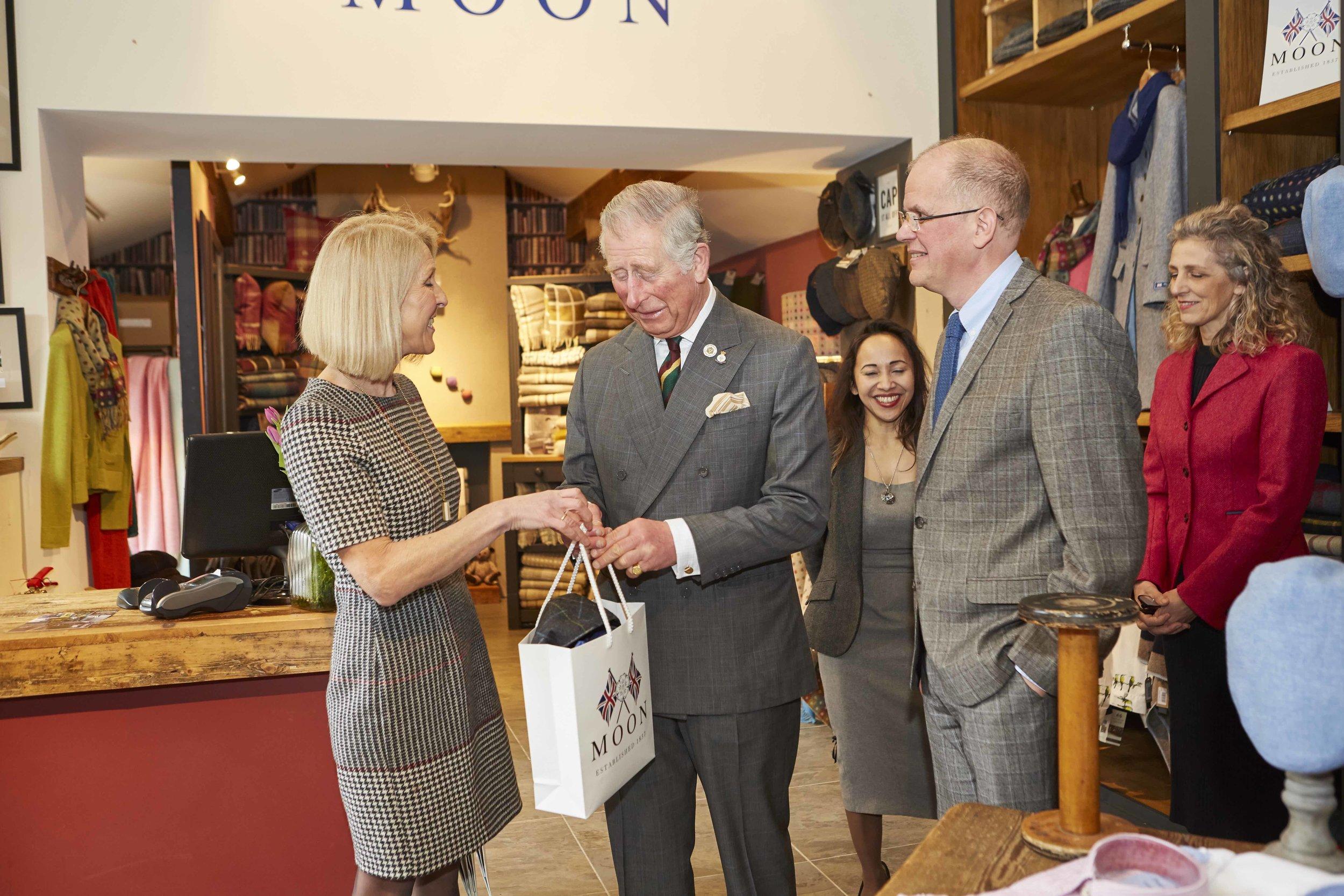 HRH Prince Charles receiving his Kempadoo Grey/Turq check tweed cap.