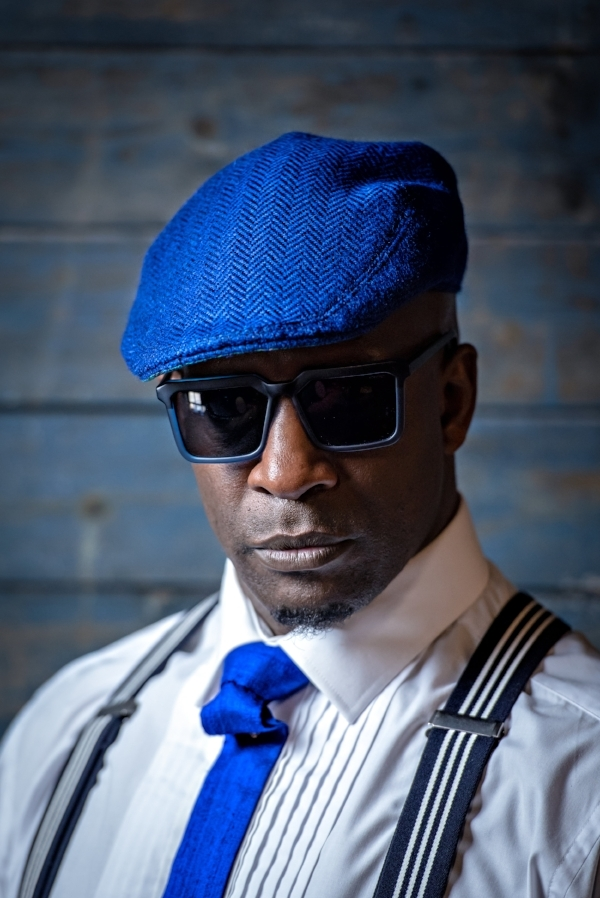 Choreographer & Dancer De-Napoli Clarke in our Peacock Blue cap